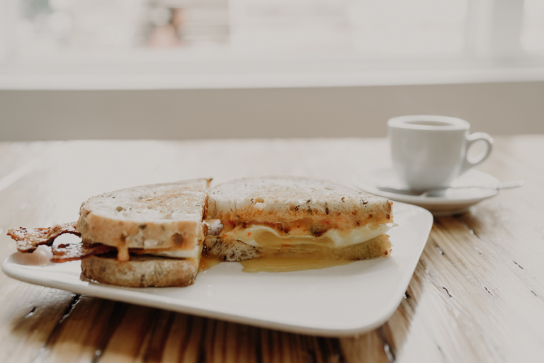 The Breakfast Sandwich: fried egg, bacon, pimento cheese on multigrain bread / Image: Brianna Long // Published 7.25.18