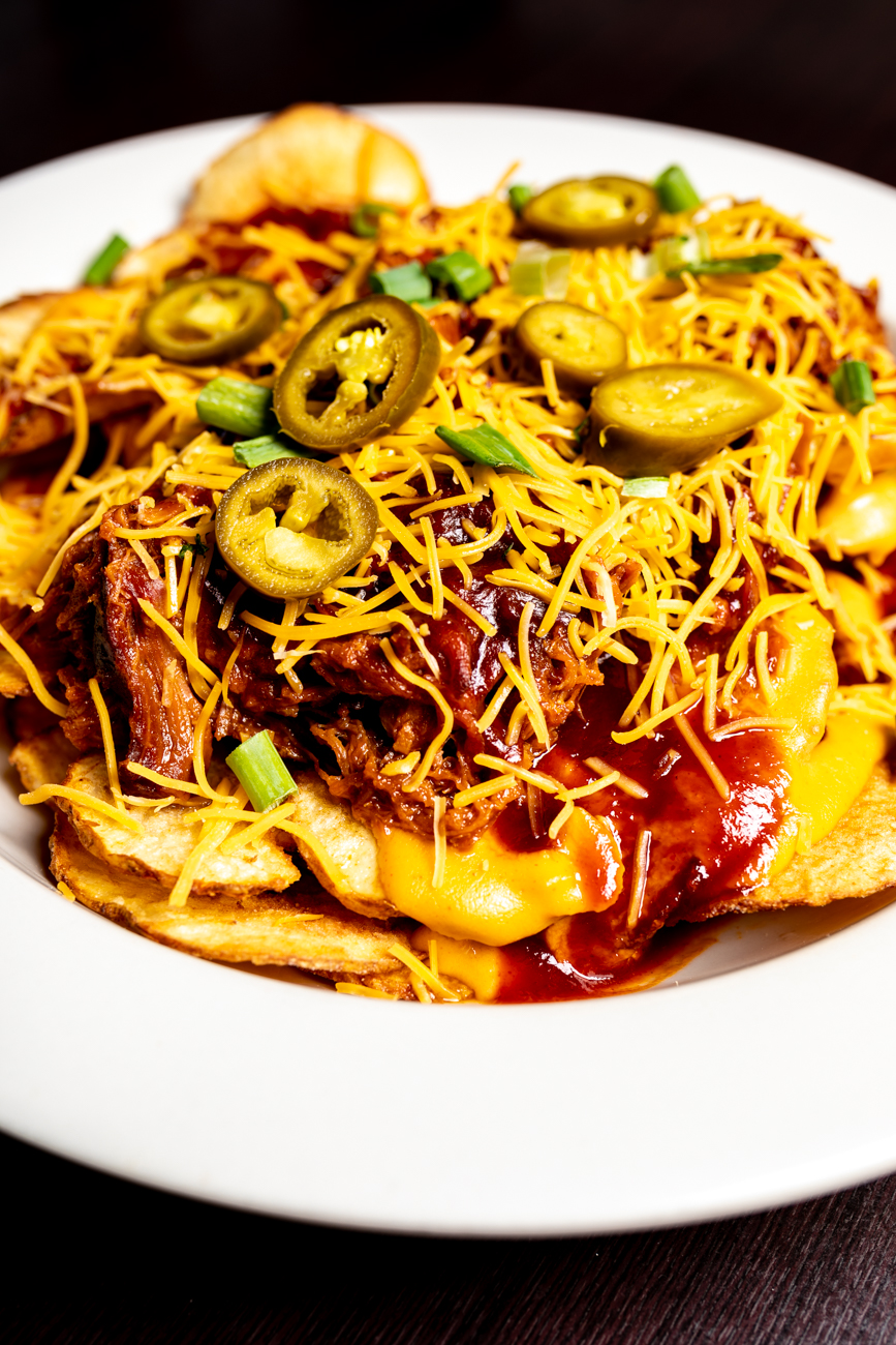 Pulled Pork Nachos: Pulled pork barbecue served on Saratoga chips topped with cheddar cheese, scallions, and jalapeños / Image: Amy Elisabeth Spasoff // Published: 11.2.2018