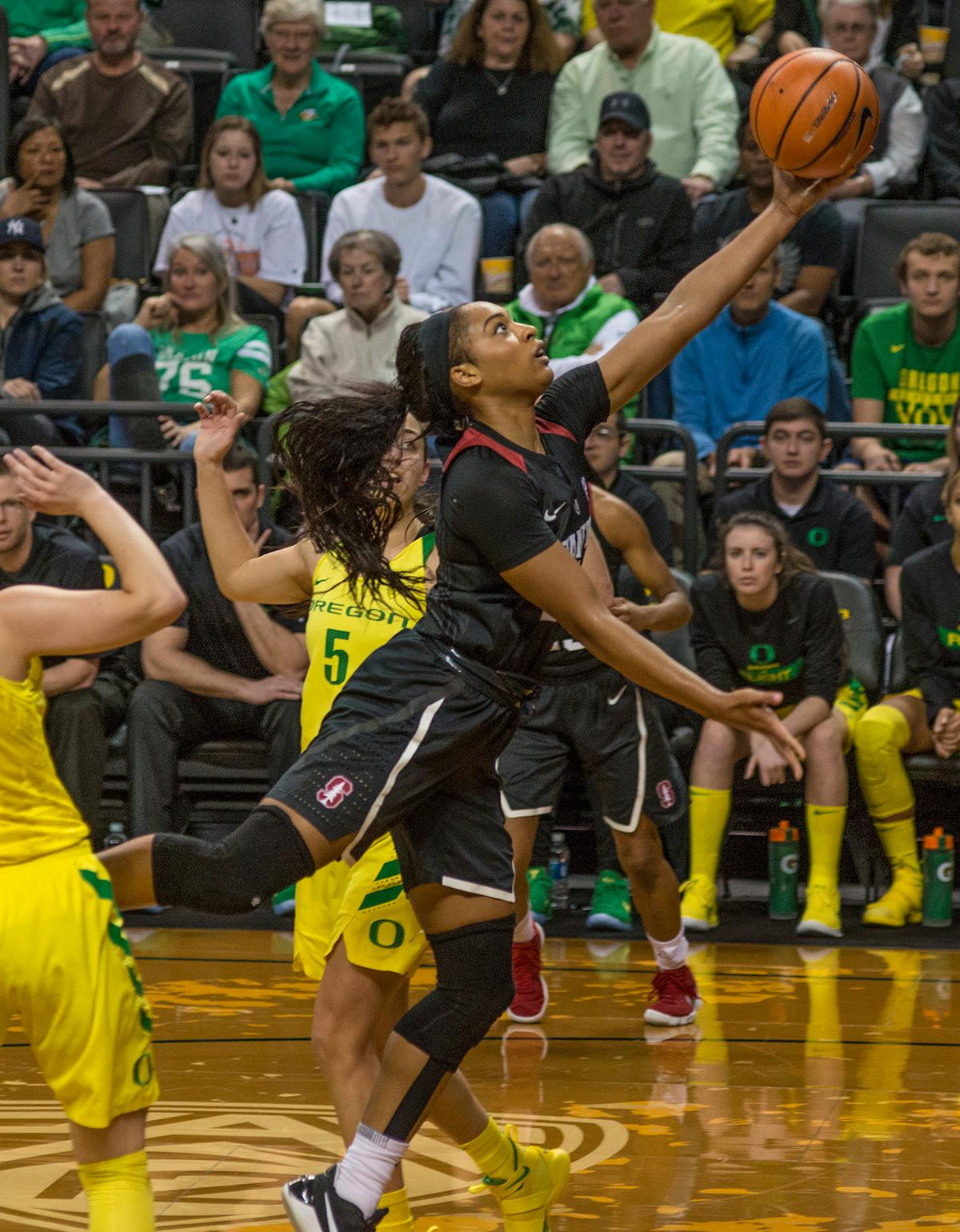Stanford Cardinal DiJonai Carrington (#21) goes up for two against the Oregon Ducks. The Stanford Cardinal defeated the Oregon Ducks 78-65 on Sunday afternoon at Matthew Knight Arena. Stanford is now 10-2 in conference play and with this loss the Ducks drop to 10-2. Leading the Stanford Cardinal was Brittany McPhee with 33 points, Alanna Smith with 14 points, and Kiana Williams with 14 points. For the Ducks Sabrina Ionescu led with 22 points, Ruthy Hebard added 16 points, and Satou Sabally put in 14 points. Photo by Dan Morrison, Oregon News Lab