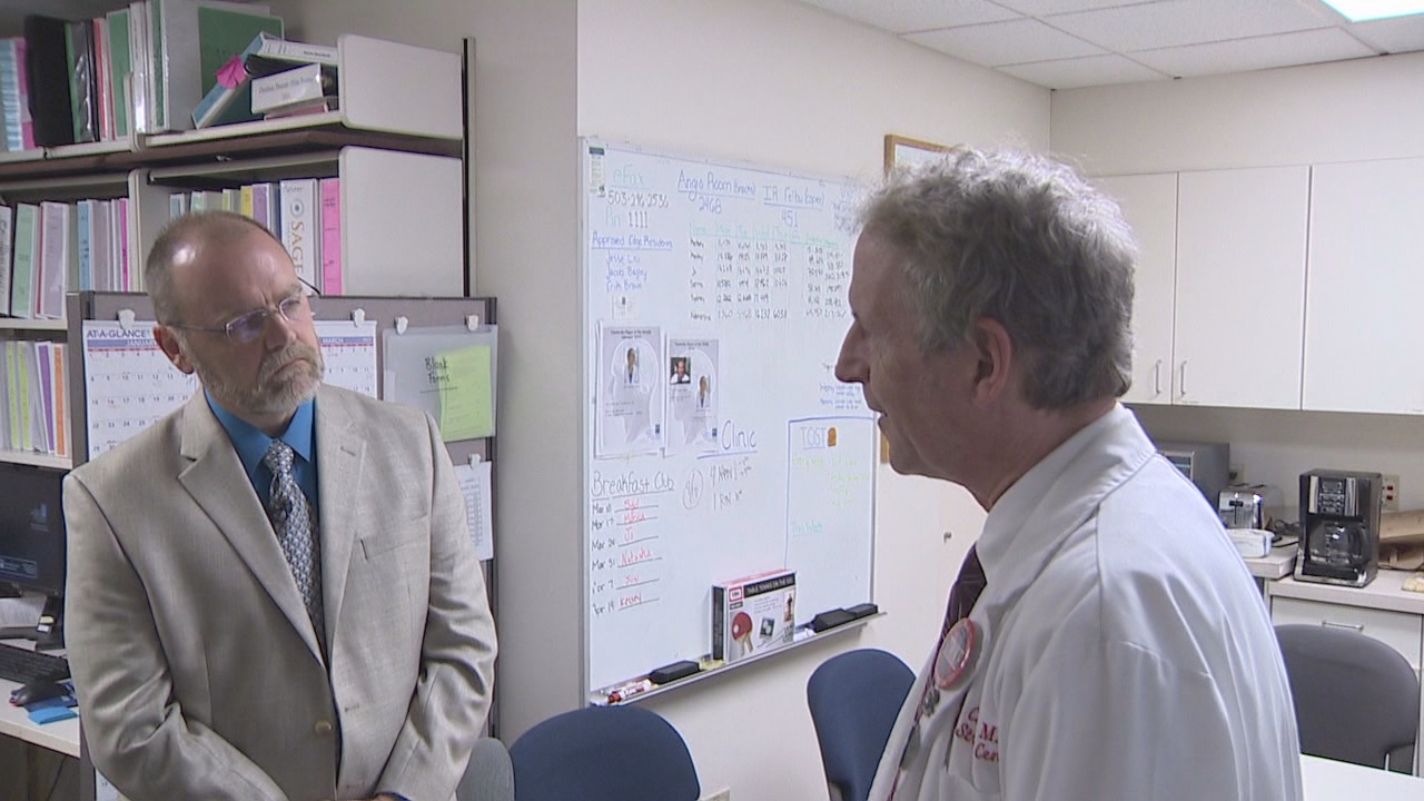 Donovan, left, with Dr. Wayne Clark. (KATU)