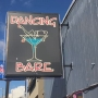 Veteran Seattle officer charged after strip club probe