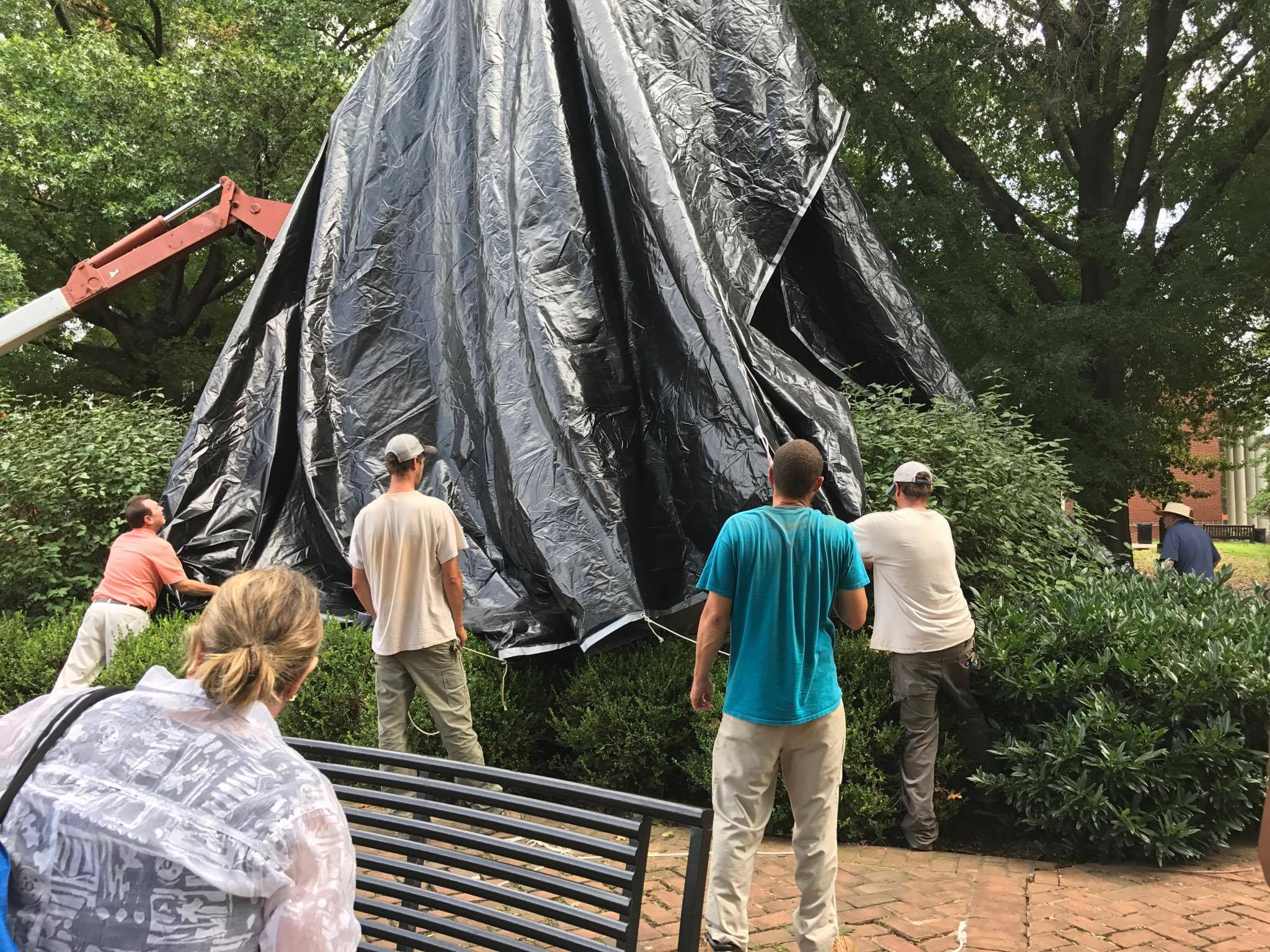 The Stonewall Jackson statue being covered in a black tarp (Photo: WSET)