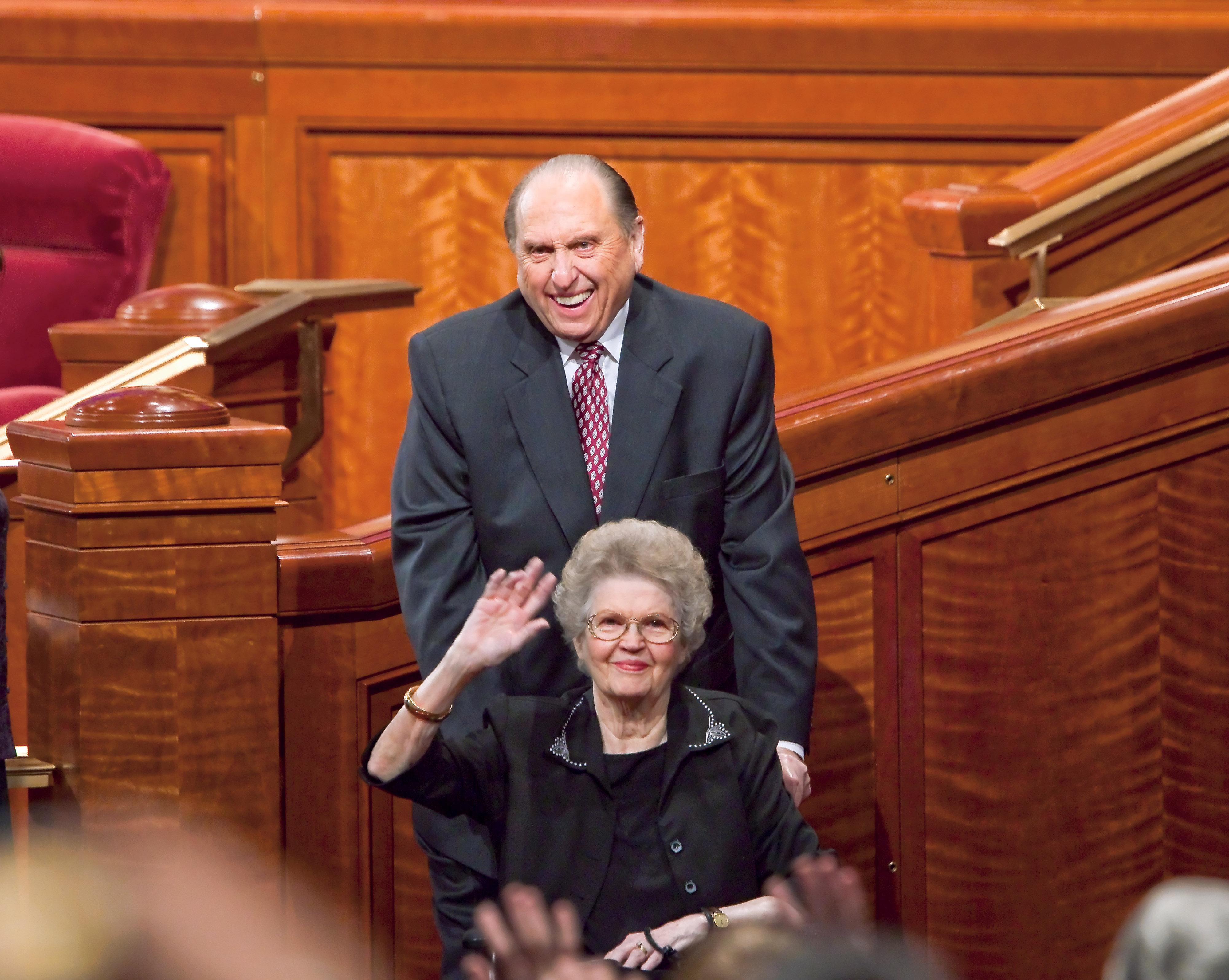 President and Sister Monson wave to the congregation following a session of general conference in April 2010. (Photo: MormonNewsroom. org)<p></p>
