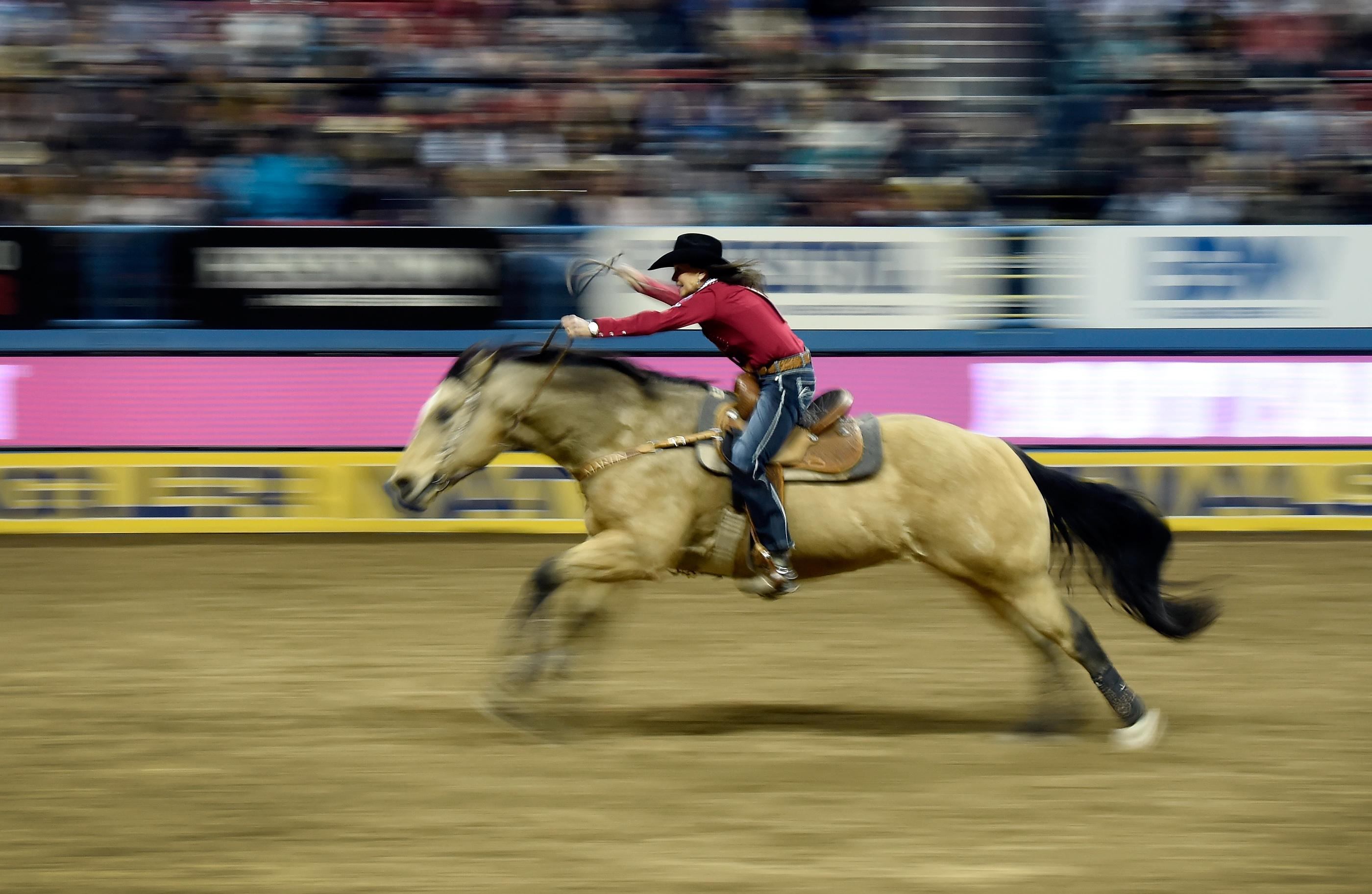 Lisa Lockhart from Oelrichs, South Dakota, competes in barrel racing during the seventh go-round of the National Finals Rodeo Wednesday, Dec. 13, 2017, in Las Vegas. CREDIT: David Becker/Las Vegas News Bureau