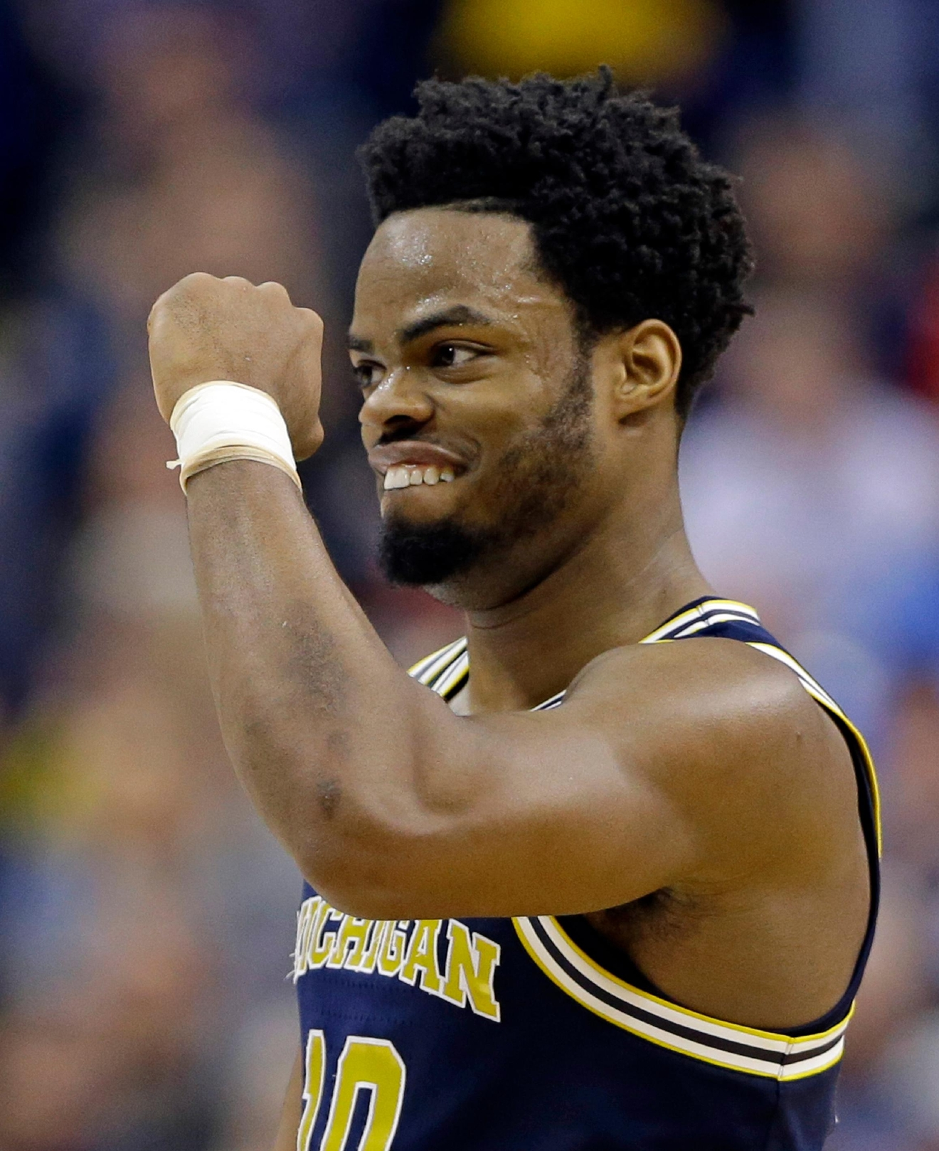 Michigan guard Derrick Walton Jr. (10) celebrates a 73-69 win over Louisville in a second-round game in the men?s NCAA college basketball tournament in Indianapolis, Sunday, March 19, 2017. (AP Photo/Michael Conroy)