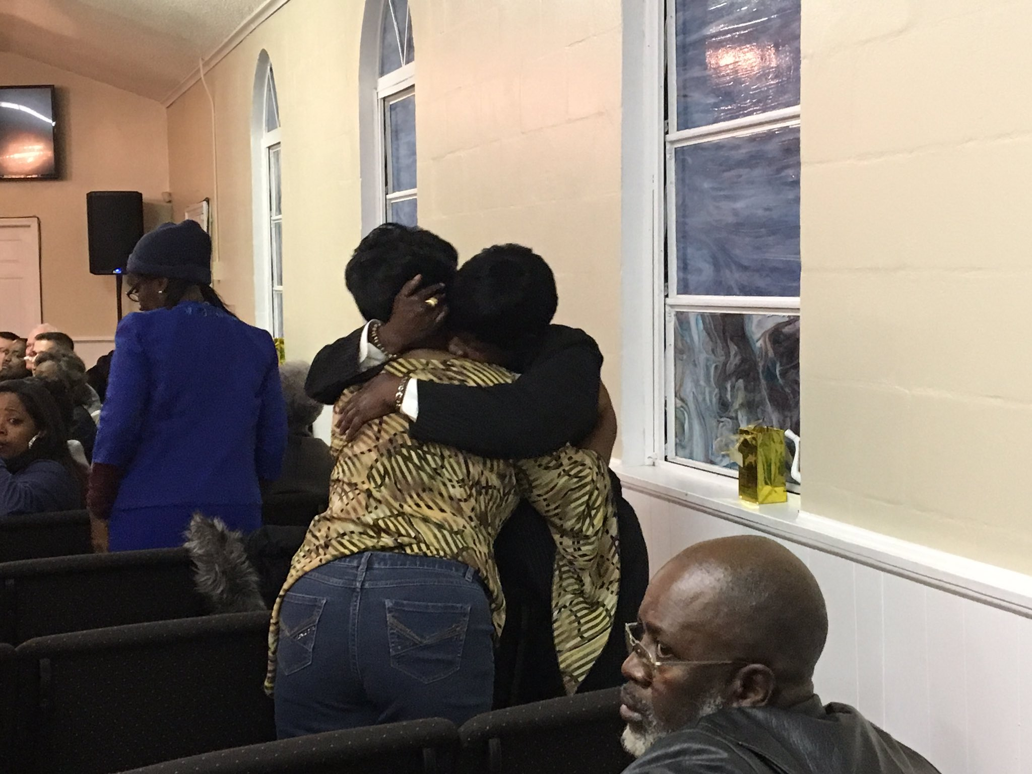 The mothers of two shooting victims embrace during the Stop The Violence rally Thursday night in Alachua. Gabby Arzola/WGFL