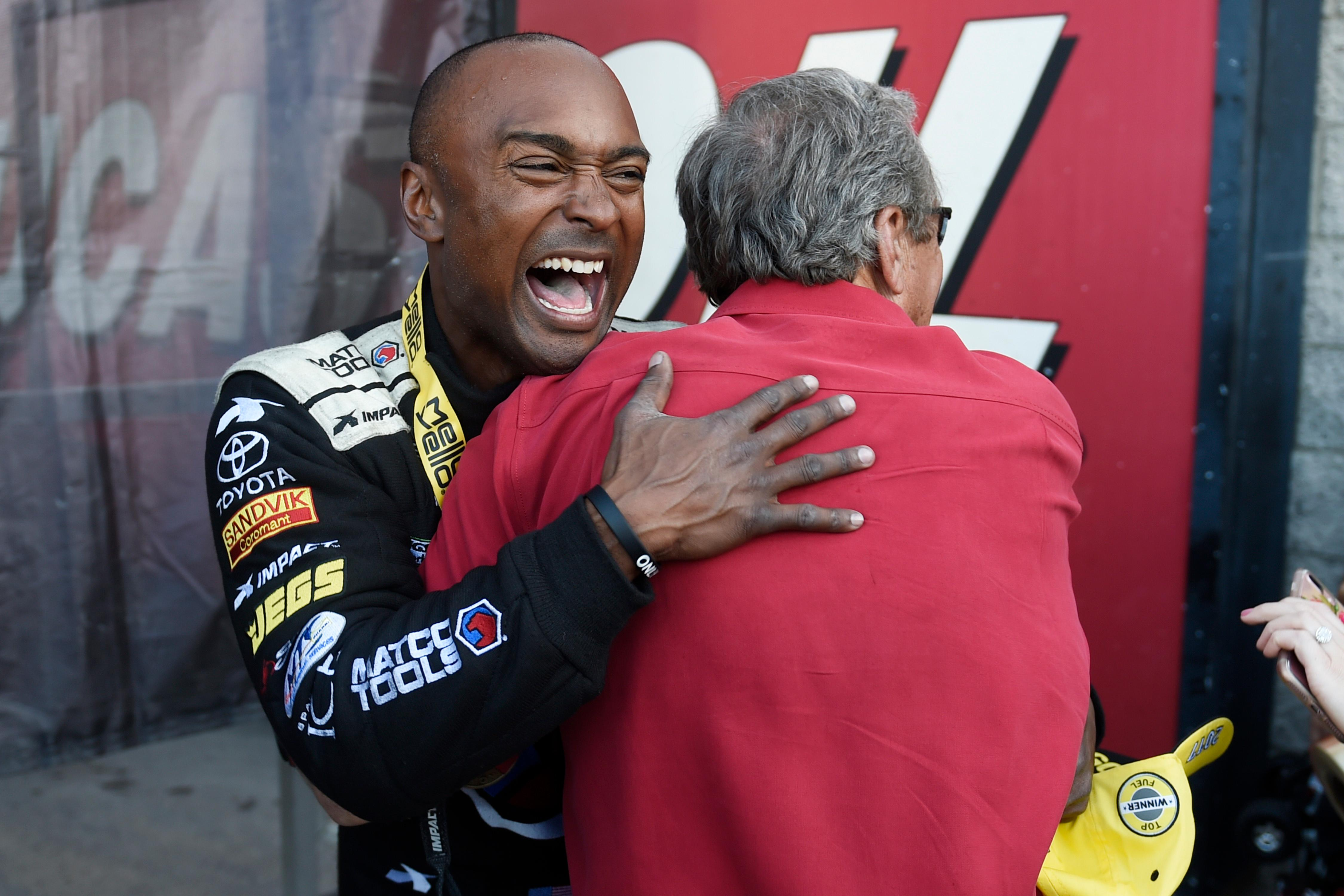 Top Fuel winner Antron Brown hugs team owner Don Schumacher during the NHRA DENSO Spark Plug Nationals at The Strip at the Las Vegas Motor Speedway Sunday, April 2, 2017. (Sam Morris/Las Vegas News Bureau)