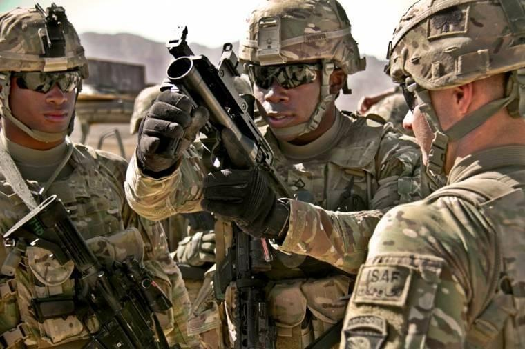 Army PFC Rohan Wright, center, prepares to fire an M203 grenade launcher at the weapons range on Forward Operating Base Thunder in Afghanistan's Paktia province. Wright, a cavalry scout, is assigned to the 101st Airborne Division's 4th Brigade Combat Team