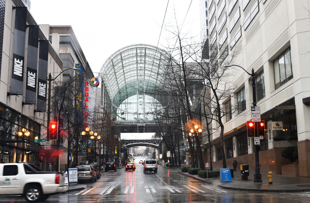The most beautiful skybridge might be the one at the Washington State Convention Center spanning Pike Street at 8th Avenue. Towering over the street, this skybridge was a point of contention among city council members, who feared it would block views of the Pike Place Market when it was built in 2001. (Image: Rebecca Mongrain/Seattle Refined)
