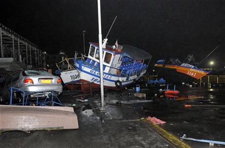 Fishing boats washed ashore by a small tsunami, sit in Caleta Riquelme, adjacent to the port, in the northern town of Iquique, Chile, after magnitude 8.2 earthqauke struck the northen coast of Chile, Wednesday, April 2, 2014.