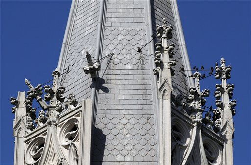 Damage is seen to decorative pieces on a steeple, at left, at Saint Patrick's Catholic Church after an earthquake was felt in Baltimore, Tuesday. / AP photo