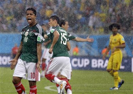 Mexico's Giovani dos Santos reacts after his goal was disallowed during the group A World Cup soccer match between Mexico & Cameroon in the Arena das Dunas in Natal, Brazil, Friday, June 13, 2014.
