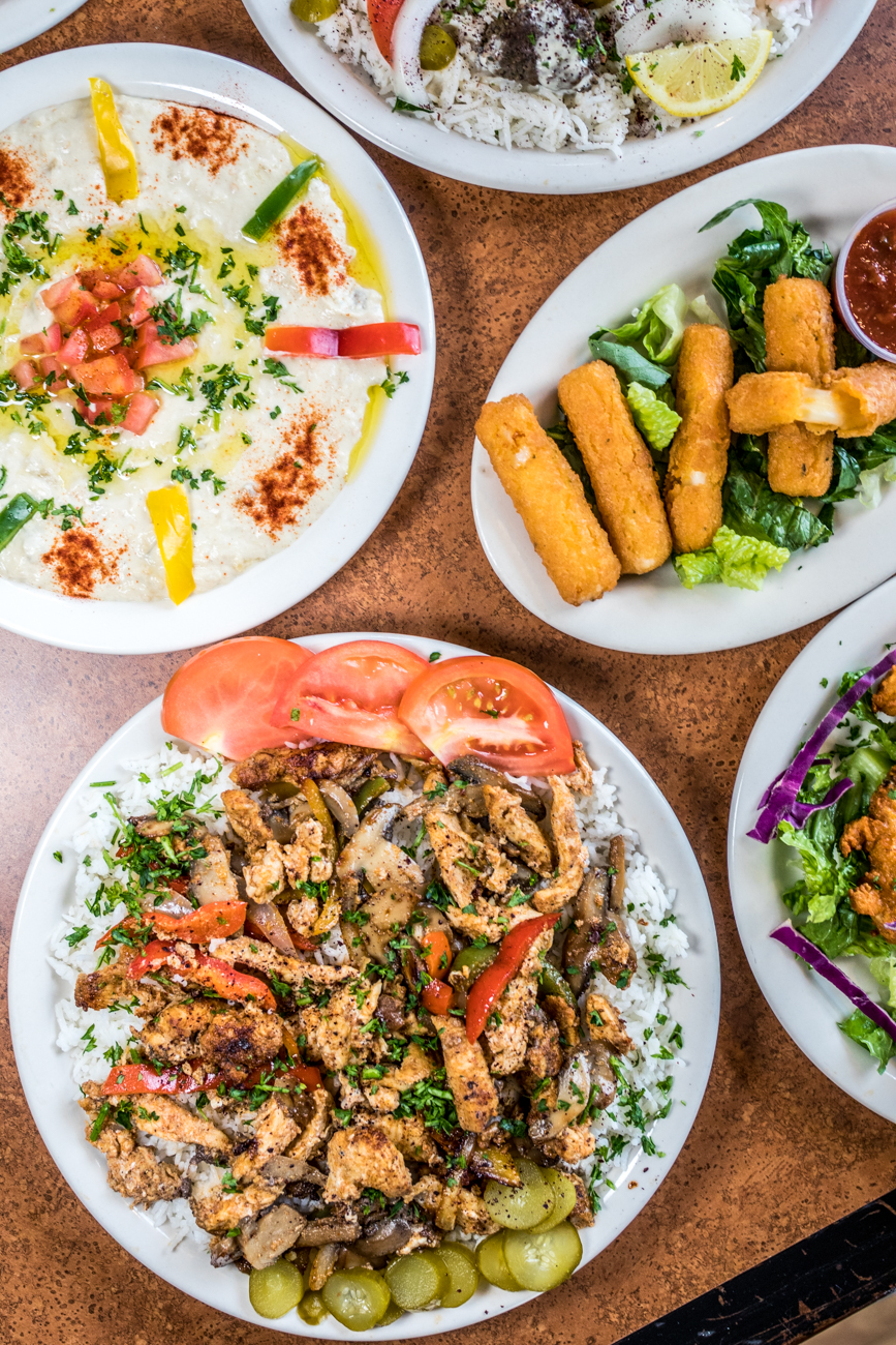 Baba Ghannouj, Spicy Potatoes, Spicy Chicken Wings, Lamb Kofta Platter, and Chicken Shawarma Platter{ }/ Image: Catherine Viox // Published: 9.23.20