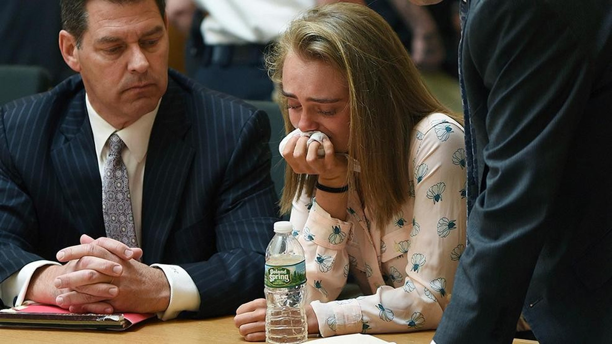 In this Friday, June 16, 2017, file photo, Michelle Carter cries while flanked by defense attorneys Joseph Cataldo, left, (Associated Press)