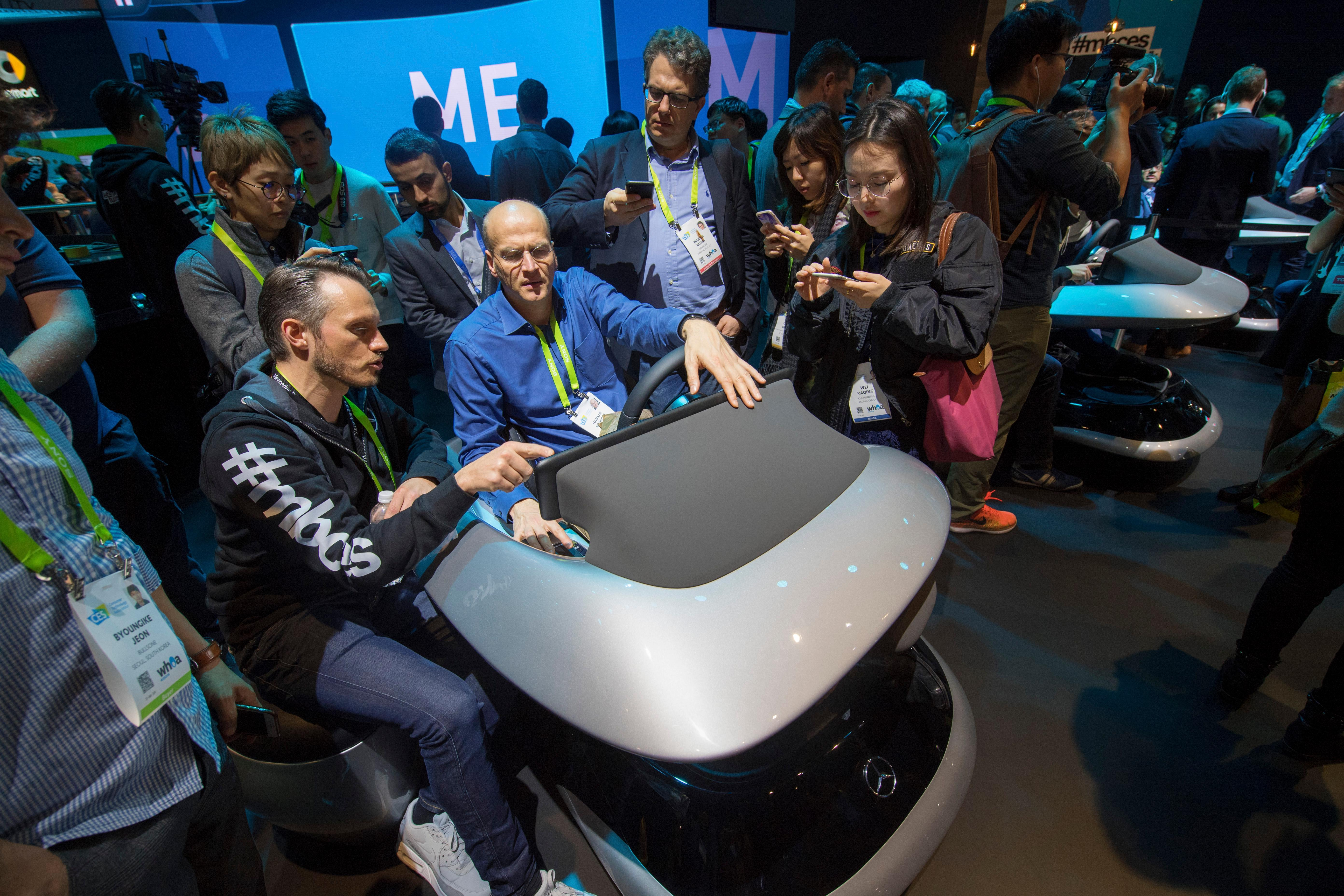 Tobias Kiefer from Mercedes demonstrates an automobile cockpit of the near future to Harold Kroeger during the second day of CES Wednesday, January 10, 2018, at the Las Vegas Convention Center. CREDIT: Sam Morris/Las Vegas News Bureau