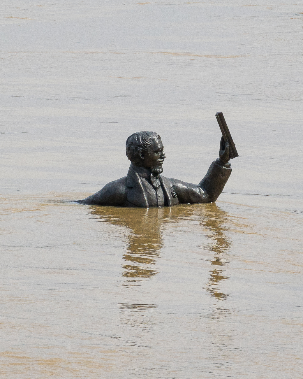The John Roebling statue in Covington almost completely underwater / Image: Phil Armstrong, Cincinnati Refined // Published: 2.26.18
