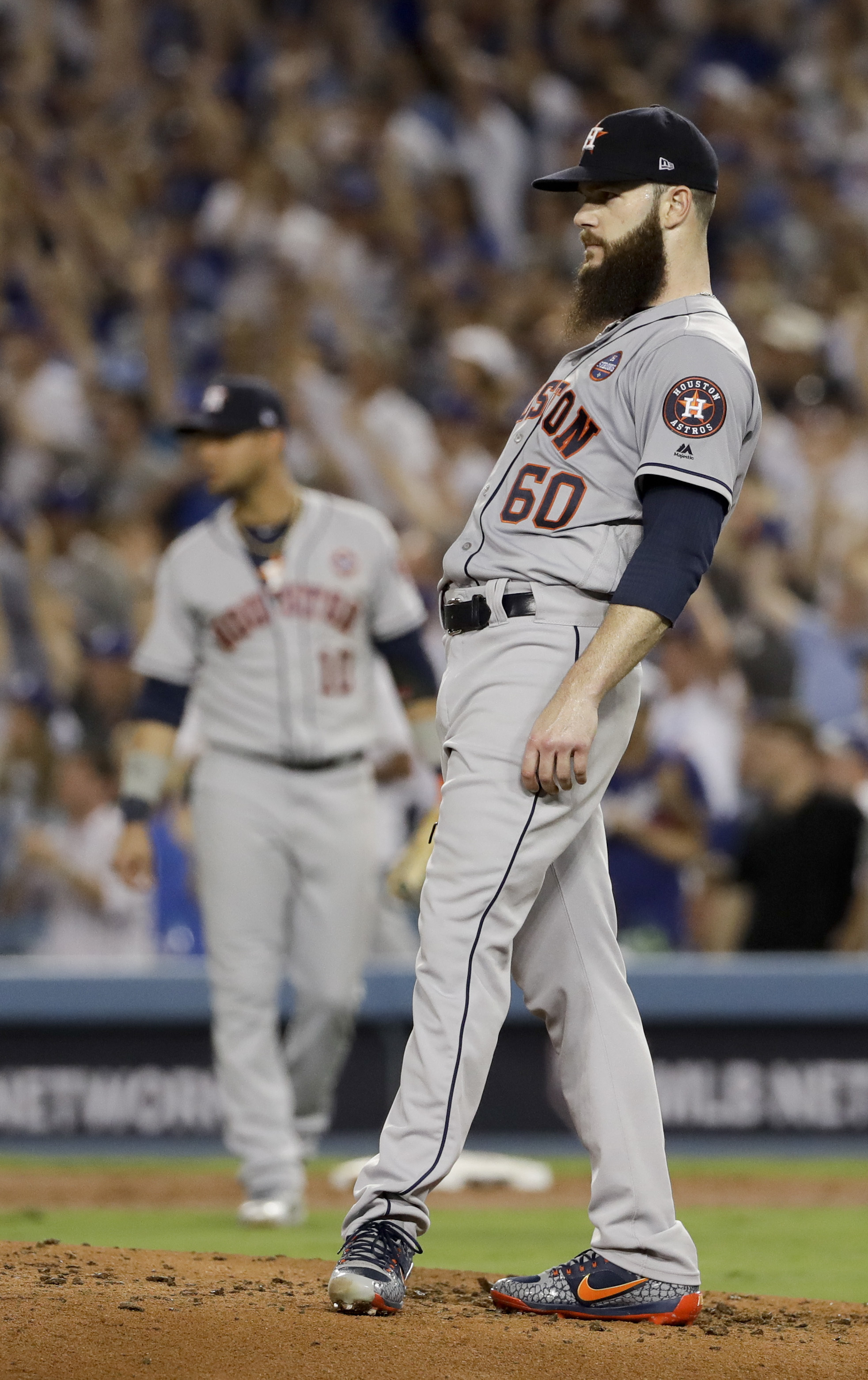 Houston Astros starting pitcher Dallas Keuchel reacts to Los Angeles Dodgers' Justin Turner's two-run home run during the sixth inning of Game 1 of baseball's World Series Tuesday, Oct. 24, 2017, in Los Angeles. (AP Photo/Matt Slocum)