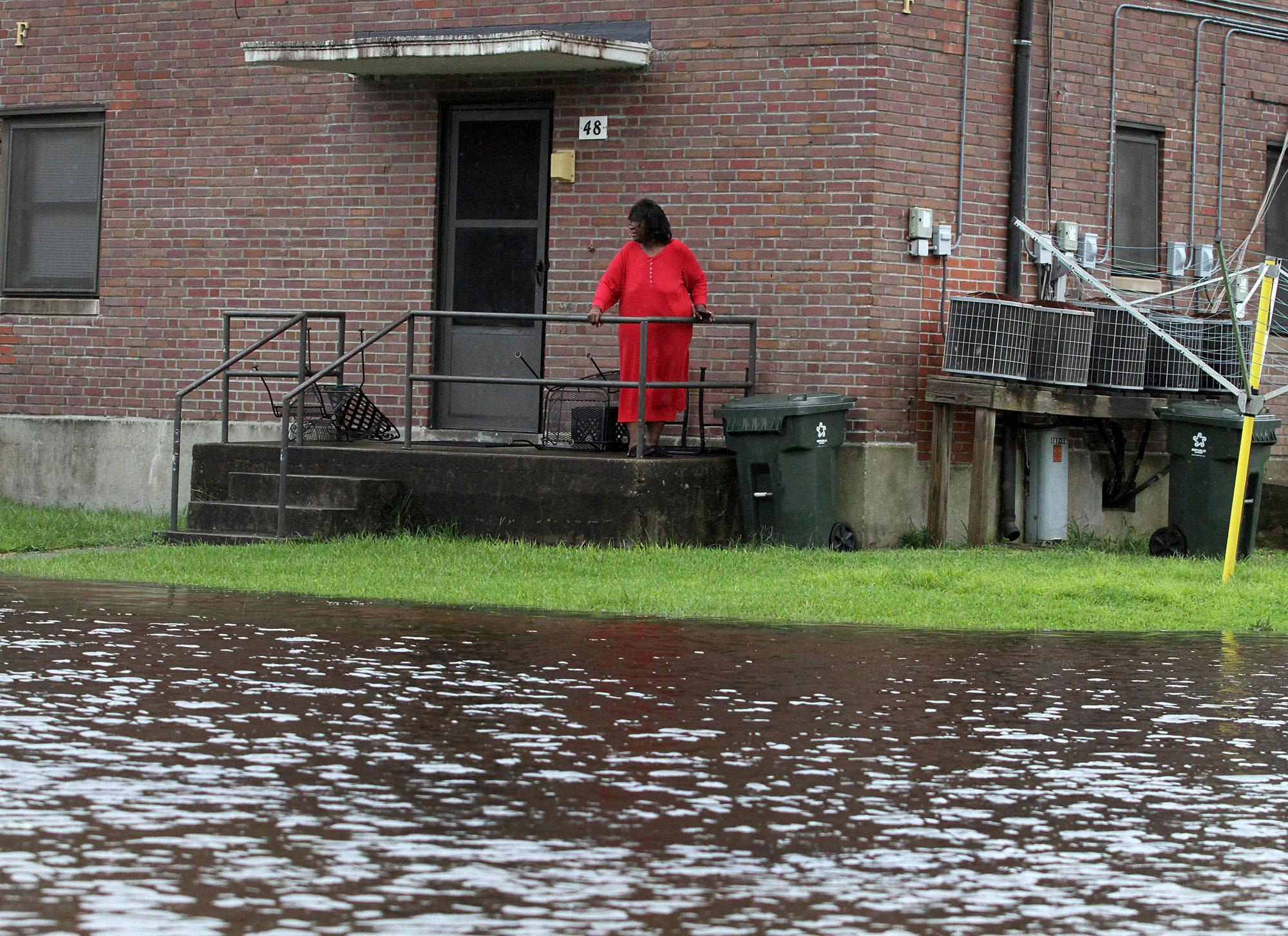 Residents at Trent Court Apartments wait out the weather as rising water gets closer to their doors in New Bern, N.C. Thursday, Sept. 13, 2018. Hurricane Florence already has inundated coastal streets with ocean water and left tens of thousands without power, and more is to come.  (Gray Whitley/Sun Journal via AP)