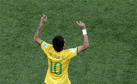 Brazil's Neymar celebrates scoring his side's first goal during the group A World Cup soccer match between Brazil and Croatia, the opening game of the tournament, in the Itaquerao Stadium in Sao Paulo, Brazil, Thursday, June 12, 2014.