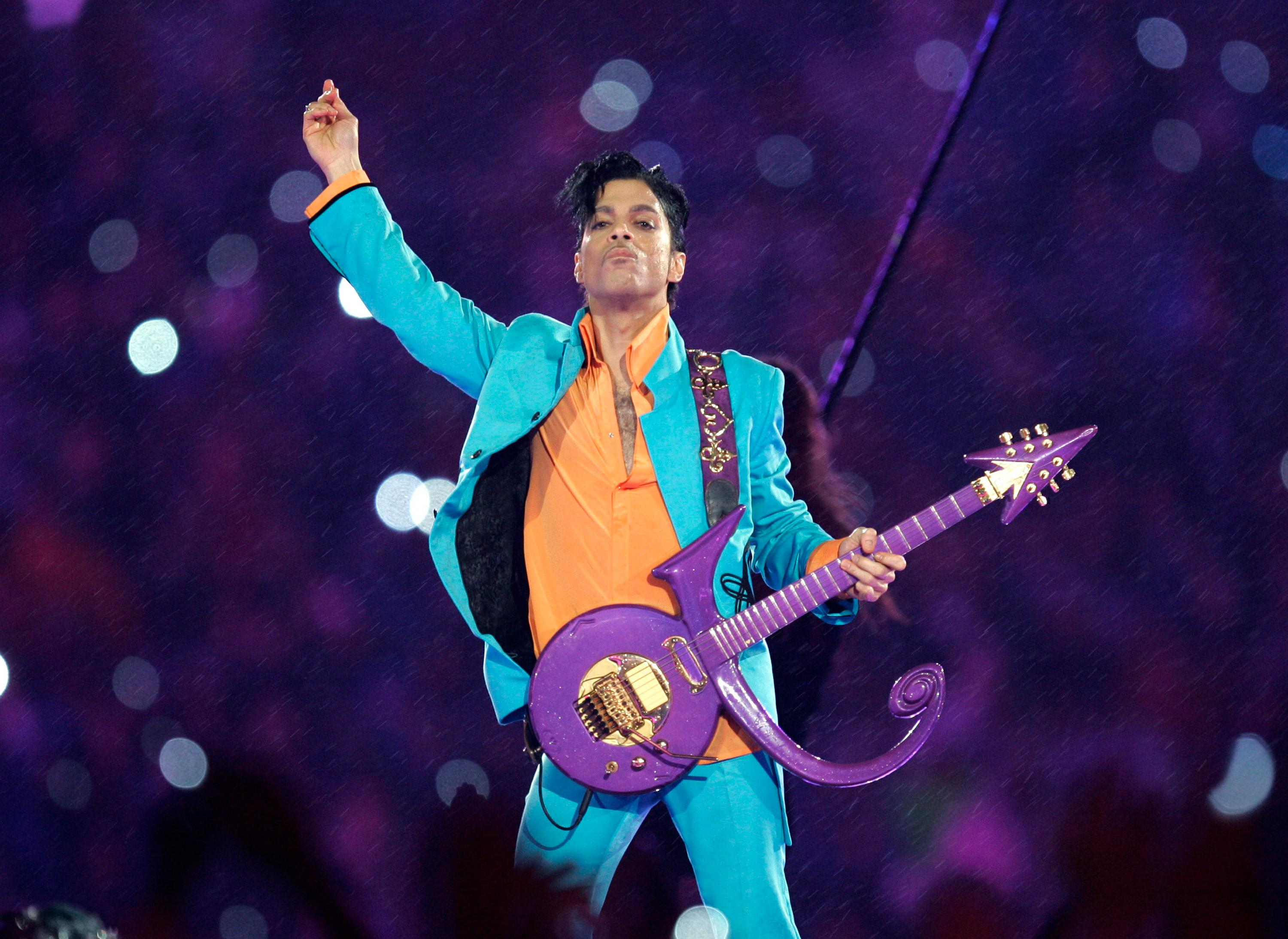 FILE - In this Feb. 4, 2007, file photo, Prince performs during the halftime show at the Super Bowl XLI NFL football game at Dolphin Stadium in Miami. Prince died at his home in Chanhassen, Minn. on April 21, 2016 at the age of 57. (AP Photo/Chris O'Meara, File)
