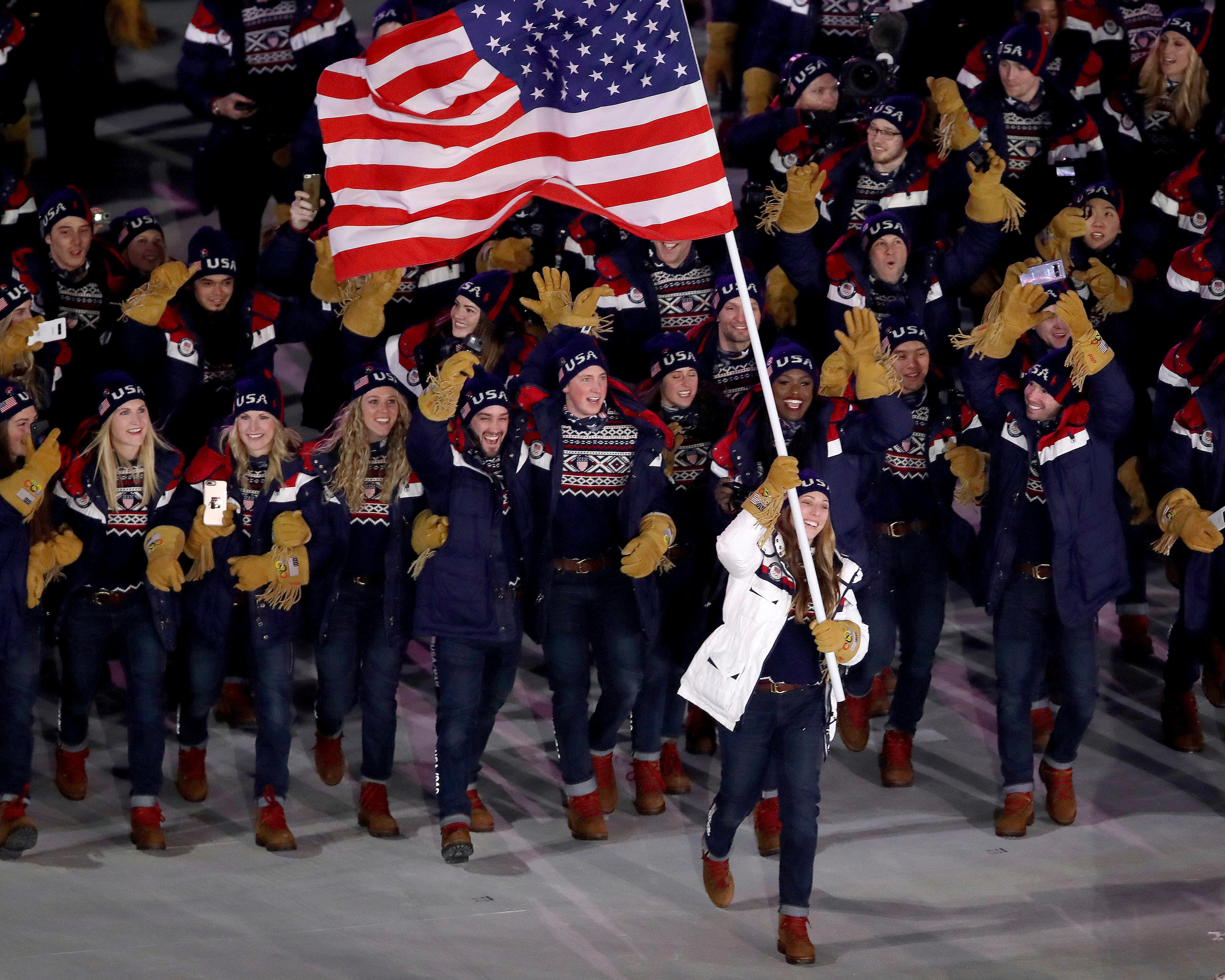 Erin Hamlin carries the flag of the United States during the opening ceremony of the 2018 Winter Olympics in Pyeongchang, South Korea, Friday, Feb. 9, 2018. (Sean Haffey/Pool Photo via AP)