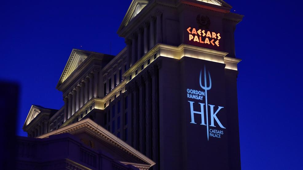 a hells kitchen logo is displayed on the side of one of the caesars palace towers during the grand opening of gordon ramsay hells kitchen at caesars - Hells Kitchen Restaurant