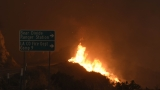 California fires threaten thousands of homes; 1 body found