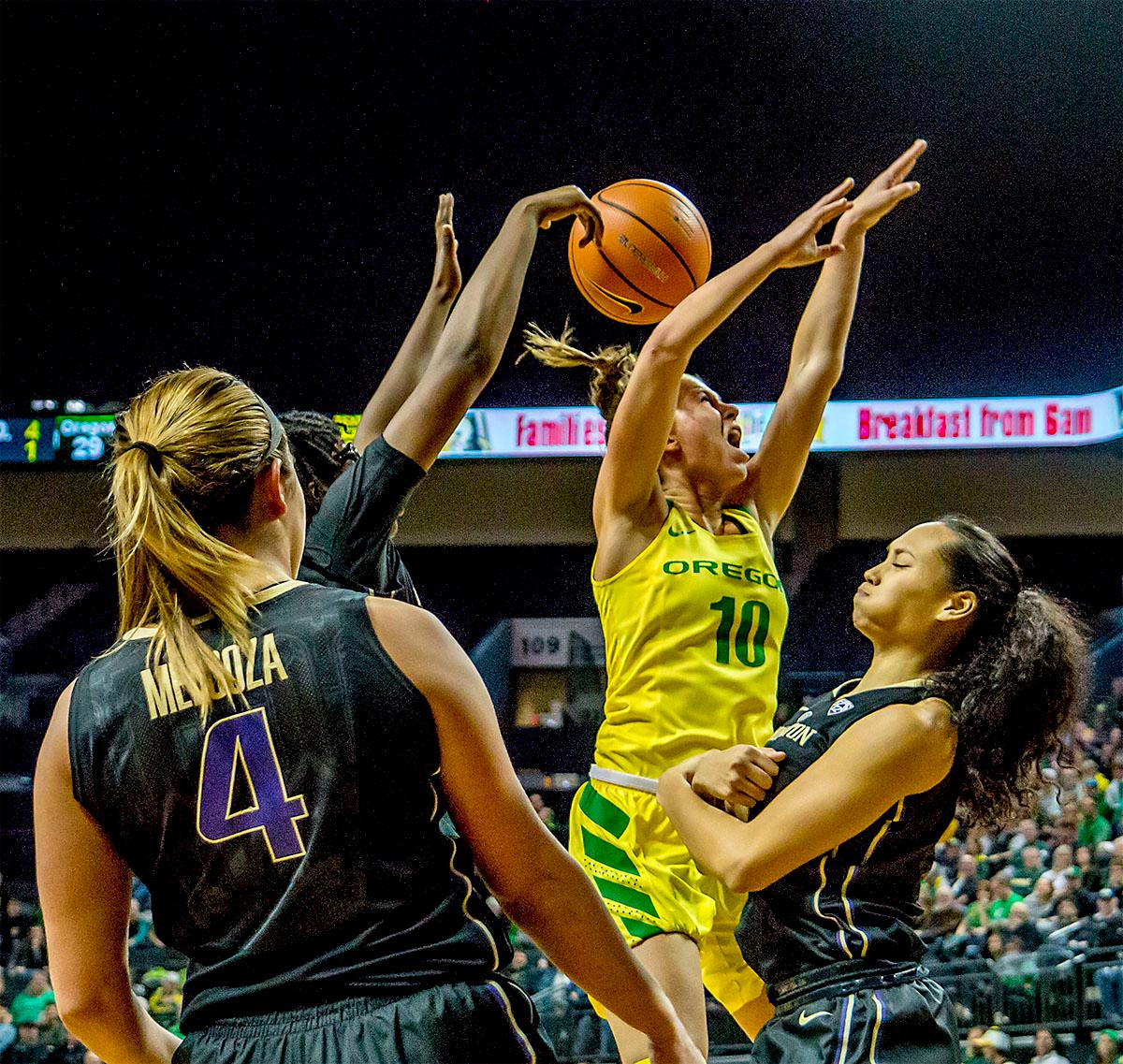 The Duck's Lexi Bando (#10) has the ball knocked from her hands as she goes for the basket. The Oregon Ducks defeated the Washington Huskies 94-83 on Sunday at Matthew Knight Arena. The victory was Head Coach Kelly Graves' 500th career win. Sabrina Ionescu also set the new NCAA all time record of 8 triple doubles in just 48 games. The previous record was 7 triple doubles in 124 games, held by Susie McConnell at Penn State. The Ducks will next face off against USC on Friday January 5th in Los Angeles. Photo by Rhianna Gelhart, Oregon News Lab