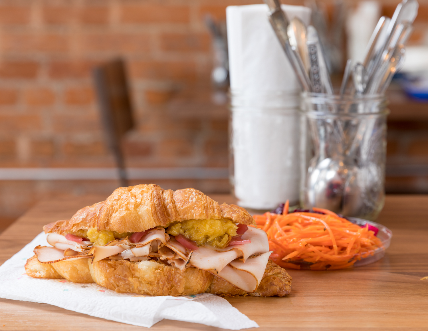 Turkey with pickled onions on croissant with squash mash and side of pickled carrot{ }/ Image: Marlene Rounds // Published: 3.12.19