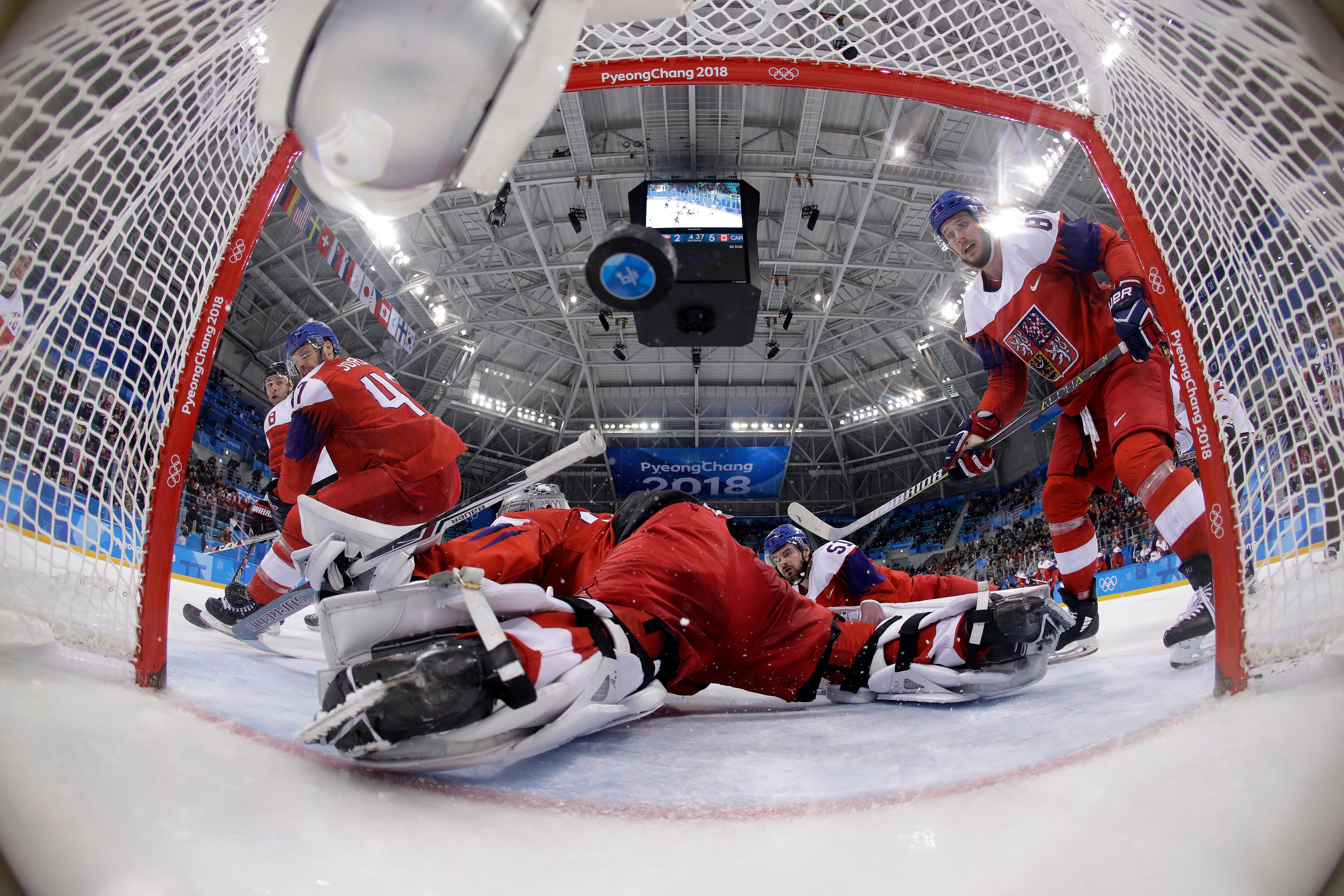 Wojtek Wolski (8), of Canada, shoots a goal past goalie Pavel Francouz (33), of the Czech Republic, during the third period of the men's bronze medal hockey game at the 2018 Winter Olympics in Gangneung, South Korea, Sunday, Feb. 25, 2018. (AP Photo/Matt Slocum, Pool)