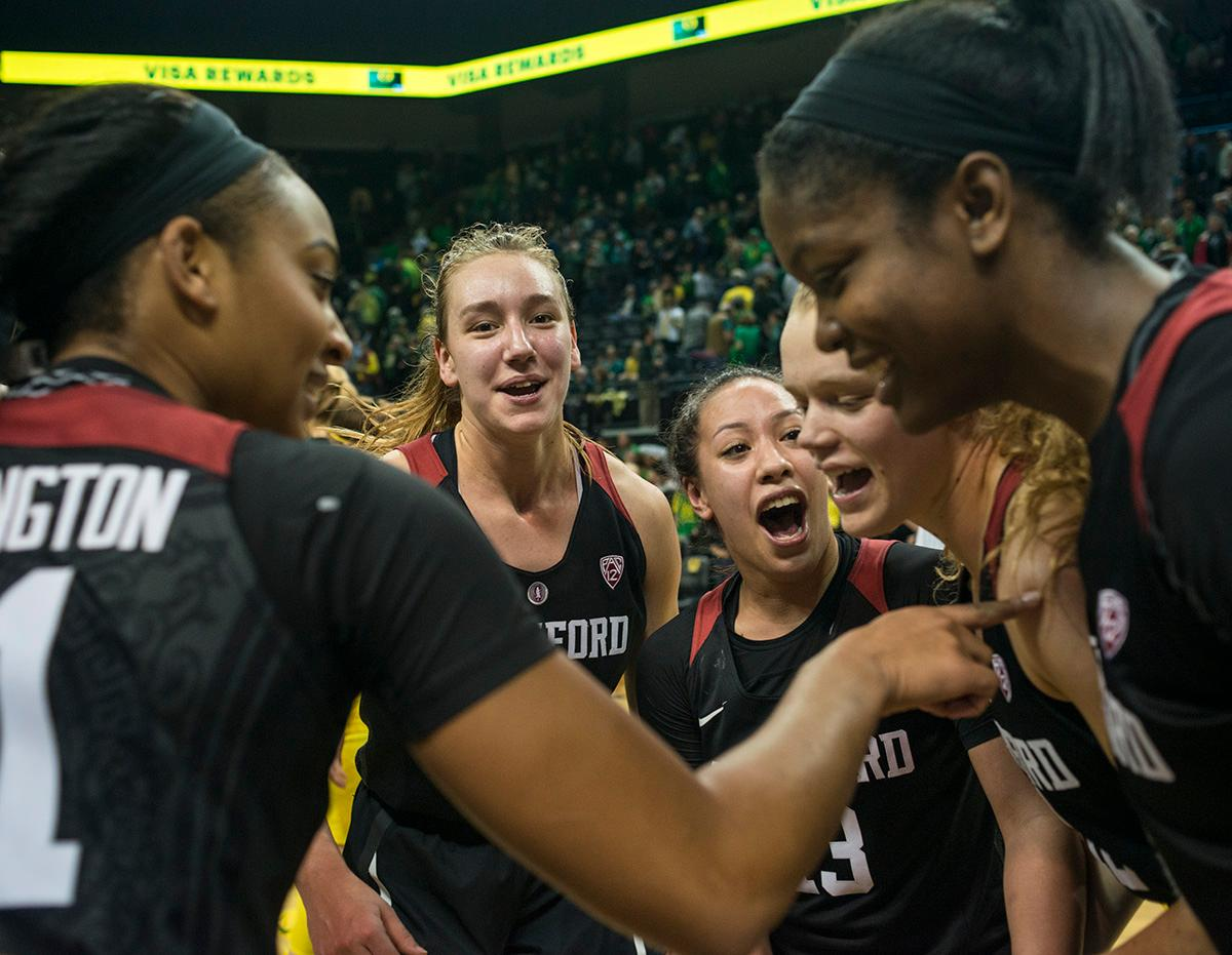 Stanford Cardinal team members celebrate their victory after the game. The Stanford Cardinal defeated the Oregon Ducks 78-65 on Sunday afternoon at Matthew Knight Arena. Stanford is now 10-2 in conference play and with this loss the Ducks drop to 10-2. Leading the Stanford Cardinal was Brittany McPhee with 33 points, Alanna Smith with 14 points, and Kiana Williams with 14 points. For the Ducks Sabrina Ionescu led with 22 points, Ruthy Hebard added 16 points, and Satou Sabally put in 14 points. Photo by Rhianna Gelhart, Oregon News Lab