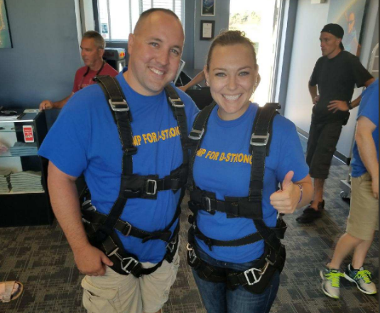 Chris and Melissa Murray suit up for their first skydive. They and 16 others jumped in support of their son's foundation to raise awareness of pediatric cancer. (WJAR)