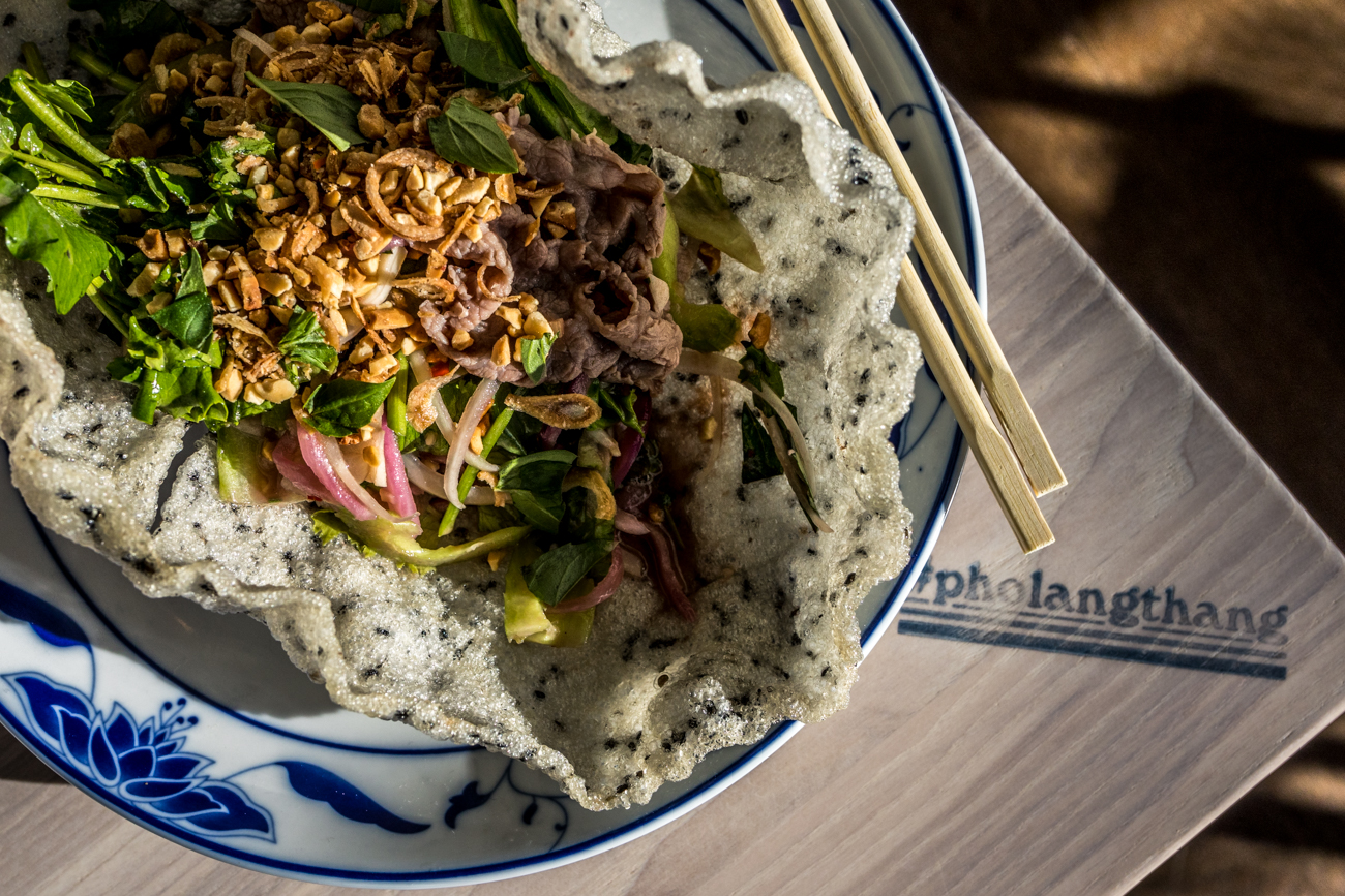 Goi Thit Bo Tron Xa Lach Xoong (Spicy Steak Watercress Salad): watercress, poached waygu eye round, mam tom pha (fermented shrimp) dressing, pickled red onions, celery, garlic, Thai basil, peanuts, and fried shallots / Image: Catherine Viox // Published: 12.28.19