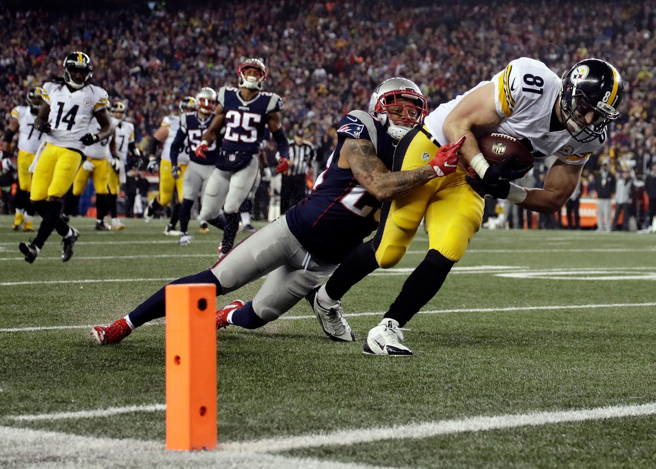 New England Patriots safety Patrick Chung (23) tackles Pittsburgh Steelers tight end Jesse James (81)short of the goal line during the first half of the AFC championship NFL football game, Sunday, Jan. 22, 2017, in Foxborough, Mass. (AP Photo/Matt Slocum)