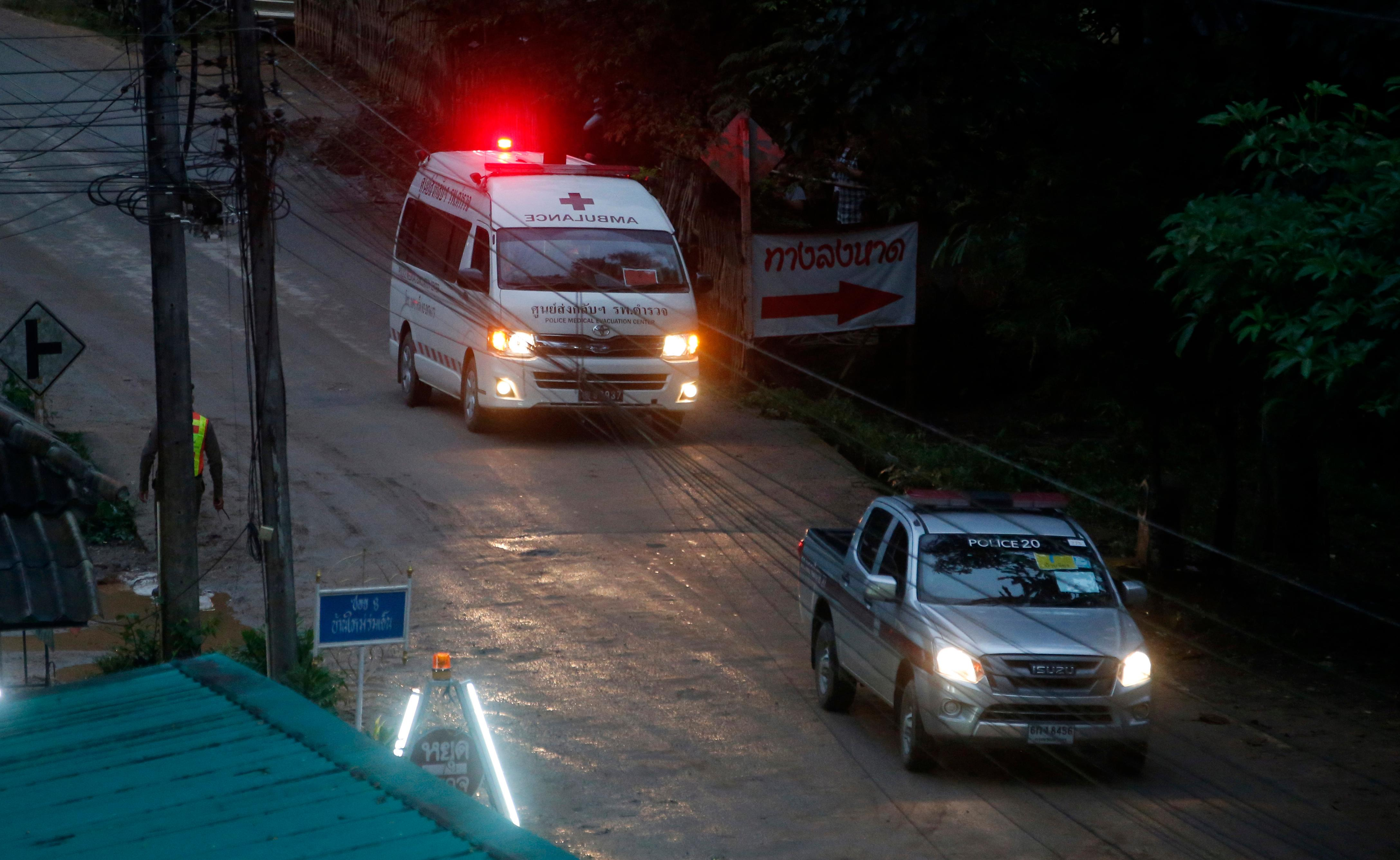 One of two ambulances leave the cave in northern Thailand hours after operation began to rescue the trapped youth soccer players and their coach, in Mae Sai, Chiang Rai province, in northern Thailand, Sunday, July 8, 2018.  Chiang Rai province acting Gov. Narongsak Osatanakorn, who is heading the operation, said earlier Sunday that 13 foreign and five Thai divers were taking part in the rescue and two divers will accompany each boy as they're gradually extracted. He said the operation began at 10 a.m., and it will take at least 11 hours for the first person to be taken out of the cave. (AP Photo/Sakchai Lalit)