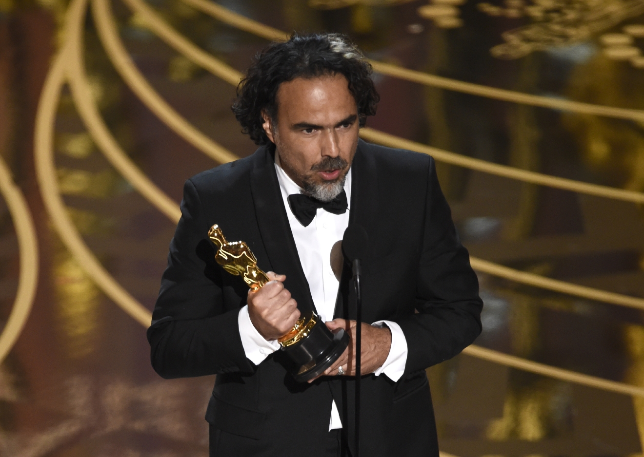 Alejandro G. Inarritu accepts the award for best director for Â?The RevenantÂ? at the Oscars on Sunday, Feb. 28, 2016, at the Dolby Theatre in Los Angeles. (Photo by Chris Pizzello/Invision/AP)
