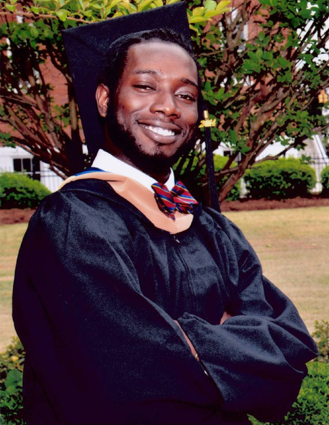 FILE-In this undated file photo made available by Anita Brewer Dantzler shows Tywanza Sanders on the day of his graduation from Allen University in Columbia, SC. Sanders was killed byDylann Roof while attending a Bible study at The Emanuel African Methodist Episcopal Church in Charleston, SC., Wednesday, June  17, 2015. During Dylan Roof's sentencing for friends and family members walked up to the witness stand and testified about the nine black church members gunned down during a Bible study. The testimony came during the sentencing phase of Dylann Roof's death penalty trial. (Anita Brewer Dantzler via AP, File)