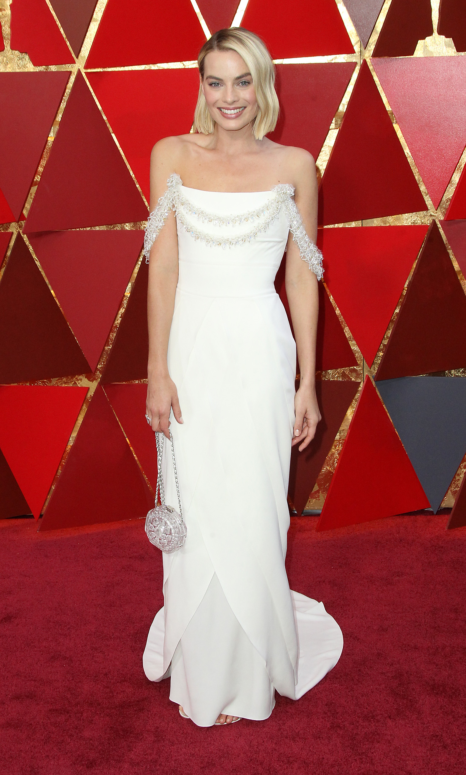 At first I wasn't totally sold on the embellishment on her classic custom Chanel gown (designed by Karl Lagerfeld himself!) as it looked a bit like Christmas garland. But alas, the overall look was just too beautiful to discount. Margot completed her look with Chanel jewelry/purse and Roger Vivier shoes. (Image: Adriana M. Barraza/WENN.com)<p></p>
