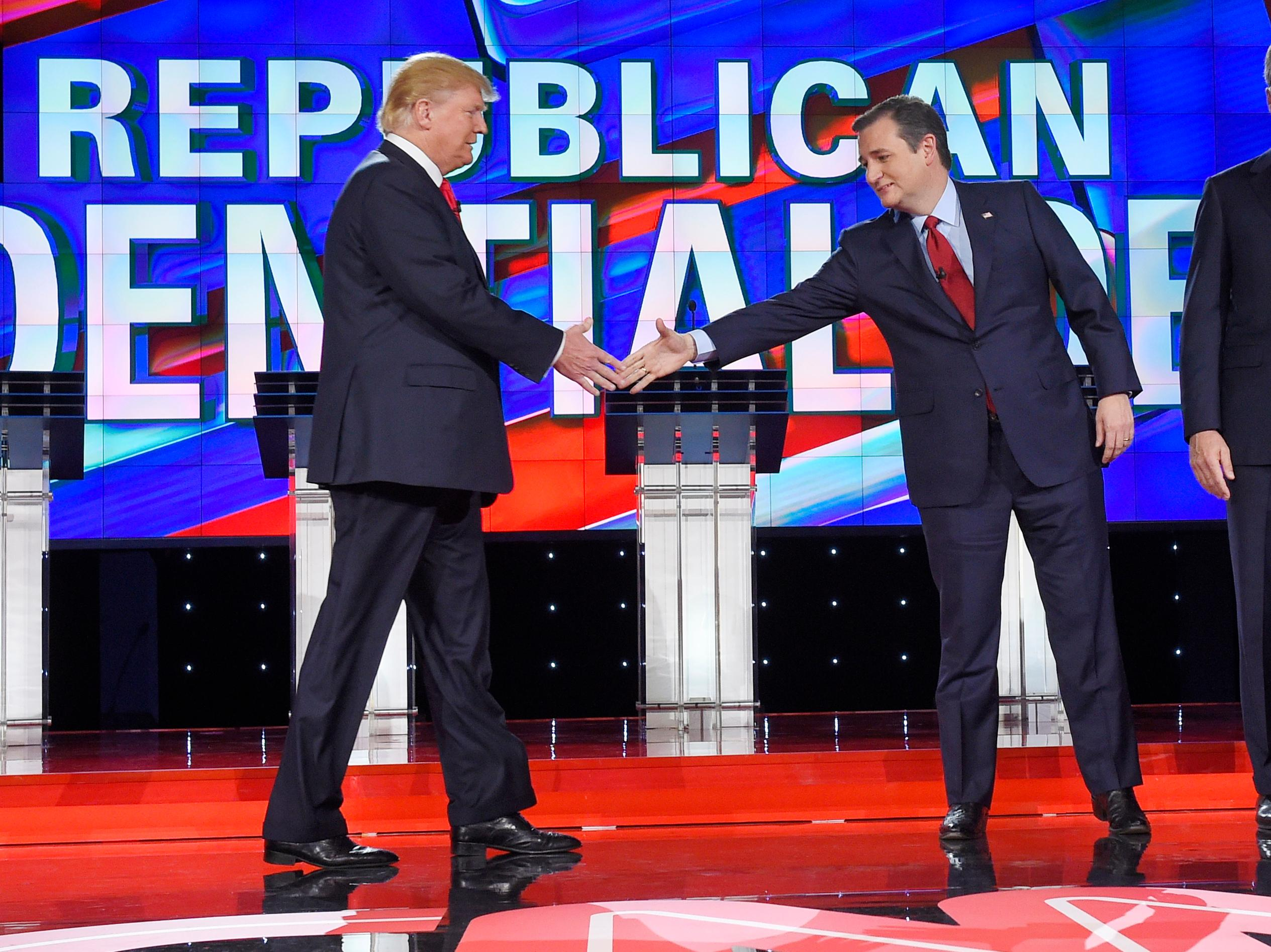 Donald Trump, left, and Ted Cruz shakes hands at the start of the CNN Republican presidential debate at the Venetian Hotel & Casino on Tuesday, Dec. 15, 2015, in Las Vegas. (AP Photo/Mark J. Terrill)