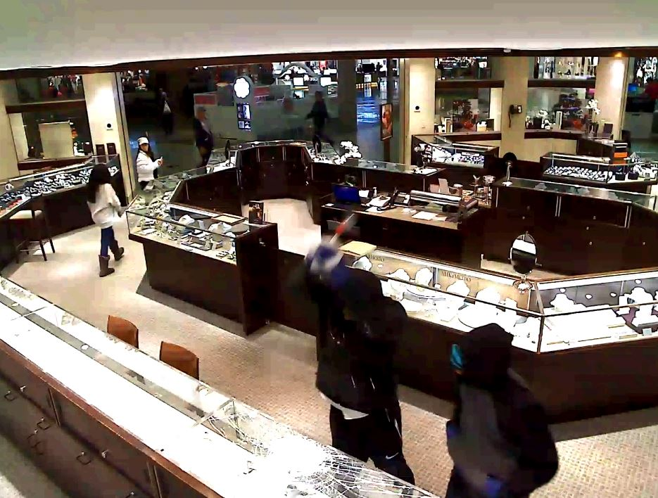Police are searching for the suspects accused of a smash and grab at the Ben Bridge Jewelry Store at Alderwood Mall in Lynnwood Tuesday night. (Video stills courtesy Lynnwood Police)