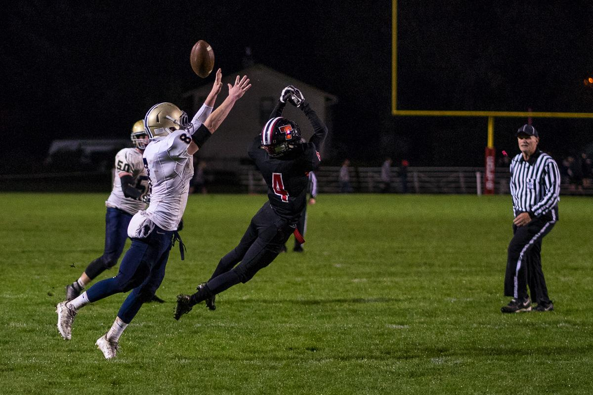Marist Spartan Jace Krier (#8) and Thurston Colt Kyle Casley (#4) attempt to catch the ball. The Thurston Colts defeated the Marist Catholic Spartans 50 – 14 to seal second place in their conference at Thurston High School on Friday, October 13. Photo by Kit MacAvoy, Oregon News Lab