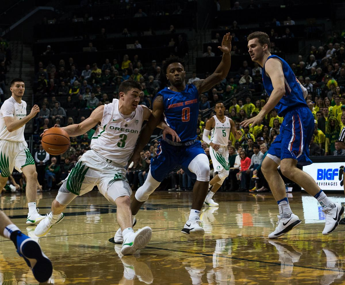 University of Oregon Duck Payton Pritchard  (#3) makes a break for the basket, circumventing Boise State Broncos Marcus Dickinson (#0) and Robin Jorch (#10). The Boise State Broncos defeated the University of Oregon Ducks 73 – 70 at Matthew Knight Arena in Eugene, Ore., on December 1, 2017. Photo by Kit MacAvoy, Oregon News Lab
