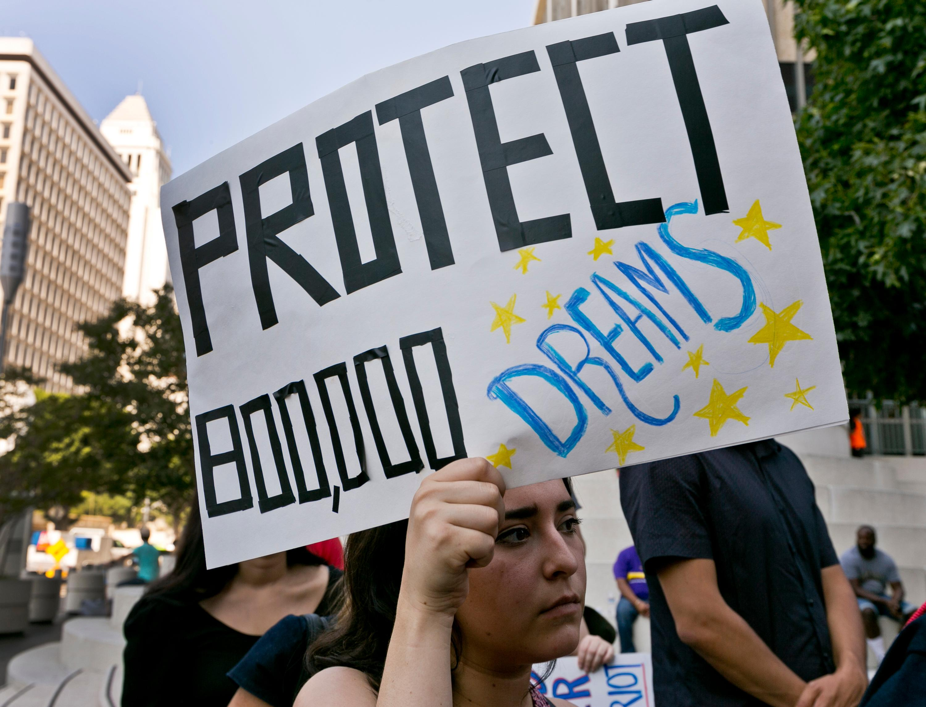 FILE - In this Sept. 1, 2017 file photo, a woman joins a rally in support of the Deferred Action for Childhood Arrivals, or DACA program, outside the Edward Roybal Federal Building in downtown Los Angeles Friday, Sept. 1, 2017.{&amp;nbsp;} (AP Photo/Damian Dovarganes, File)<p></p>
