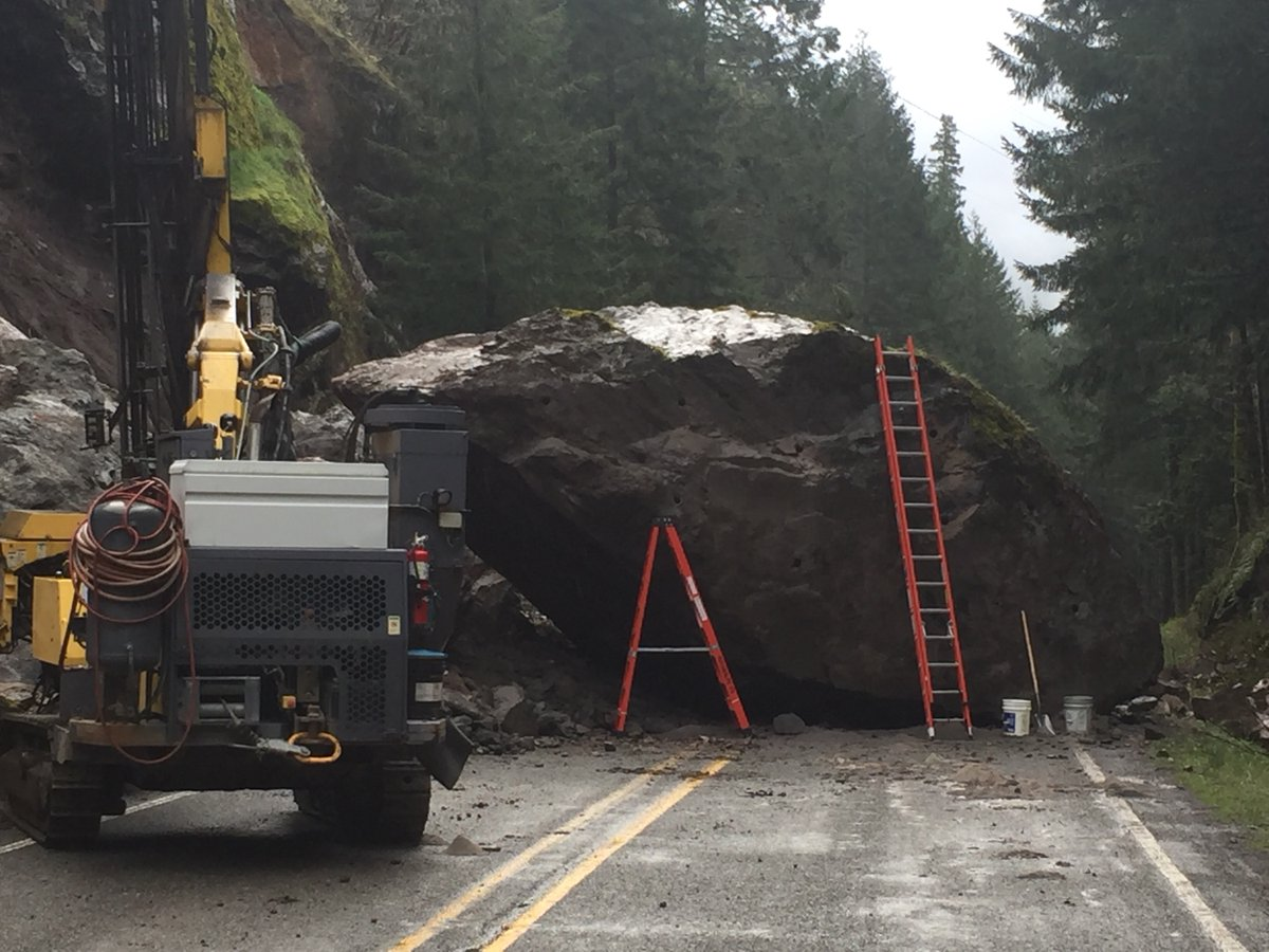 A 12-foot tall, 200-ton rock fell on Highway 138E just after midnight Thursday, blocking the road 10 miles east of Glide on the Rogue-Umpqua Scenic Byway. (Via OSP)