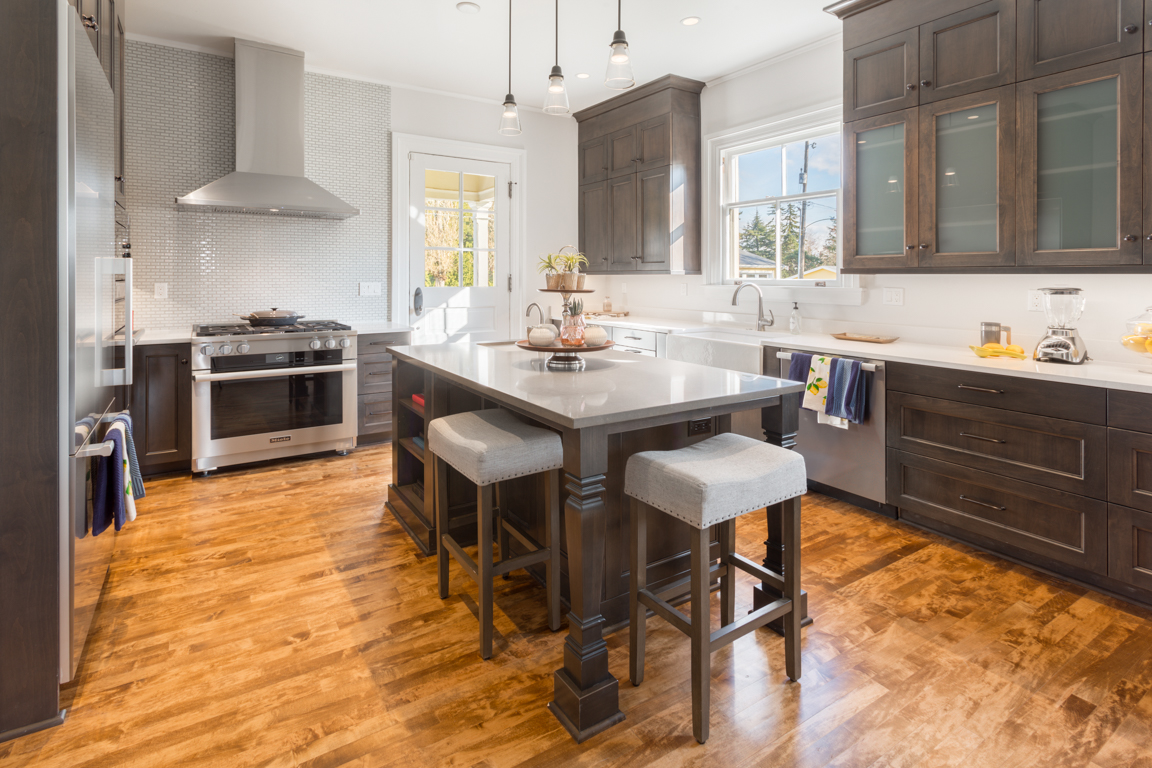 The Frederick's kitchen was completely transformed into a generously and bright gathering space complete with executive-quality Miele appliances, including a wine fridge, gas cooking, and two ovens.