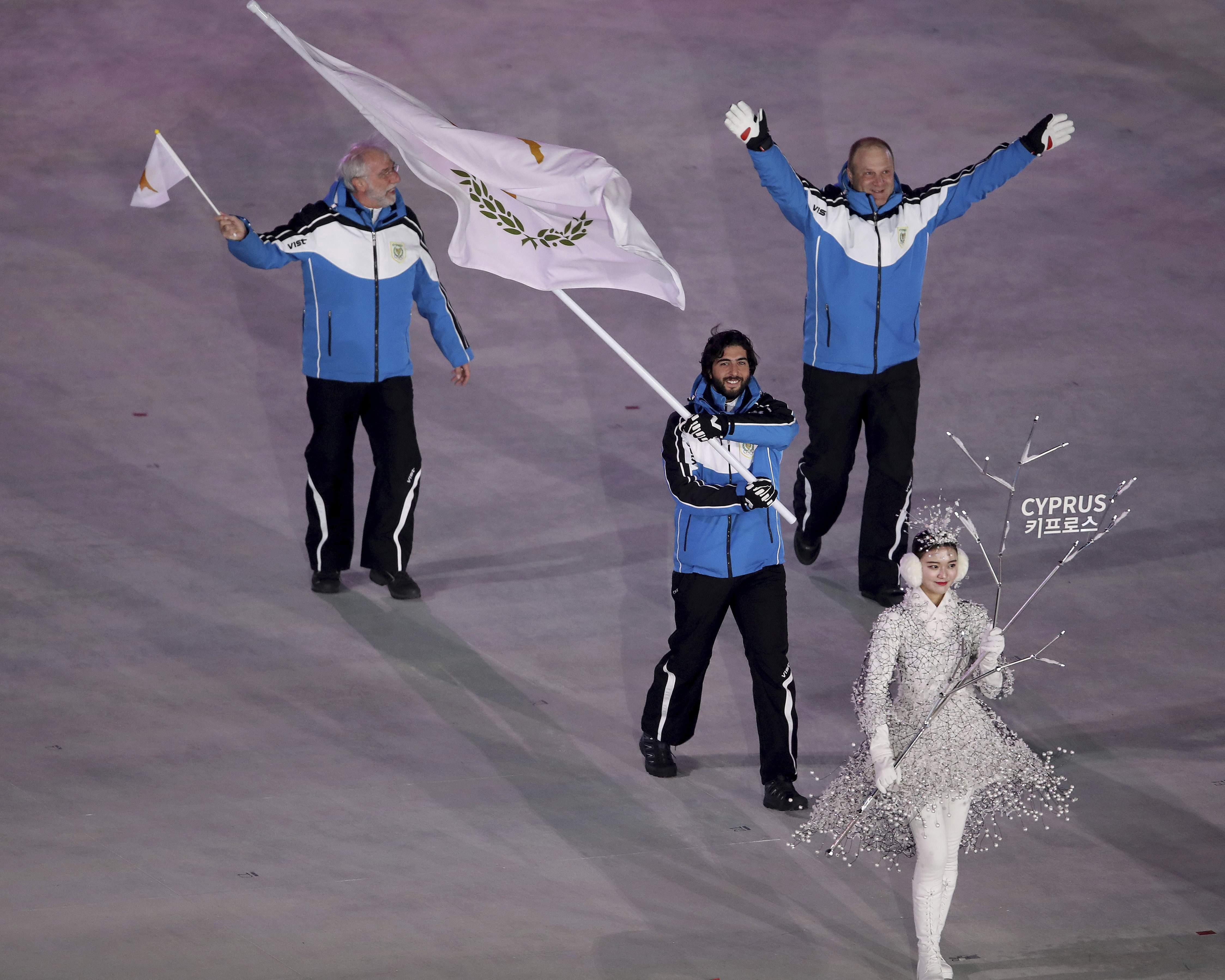 Dinos Lefkaritis carries the flag of Cyprus during the opening ceremony of the 2018 Winter Olympics in Pyeongchang, South Korea, Friday, Feb. 9, 2018. (Sean Haffey/Pool Photo via AP)