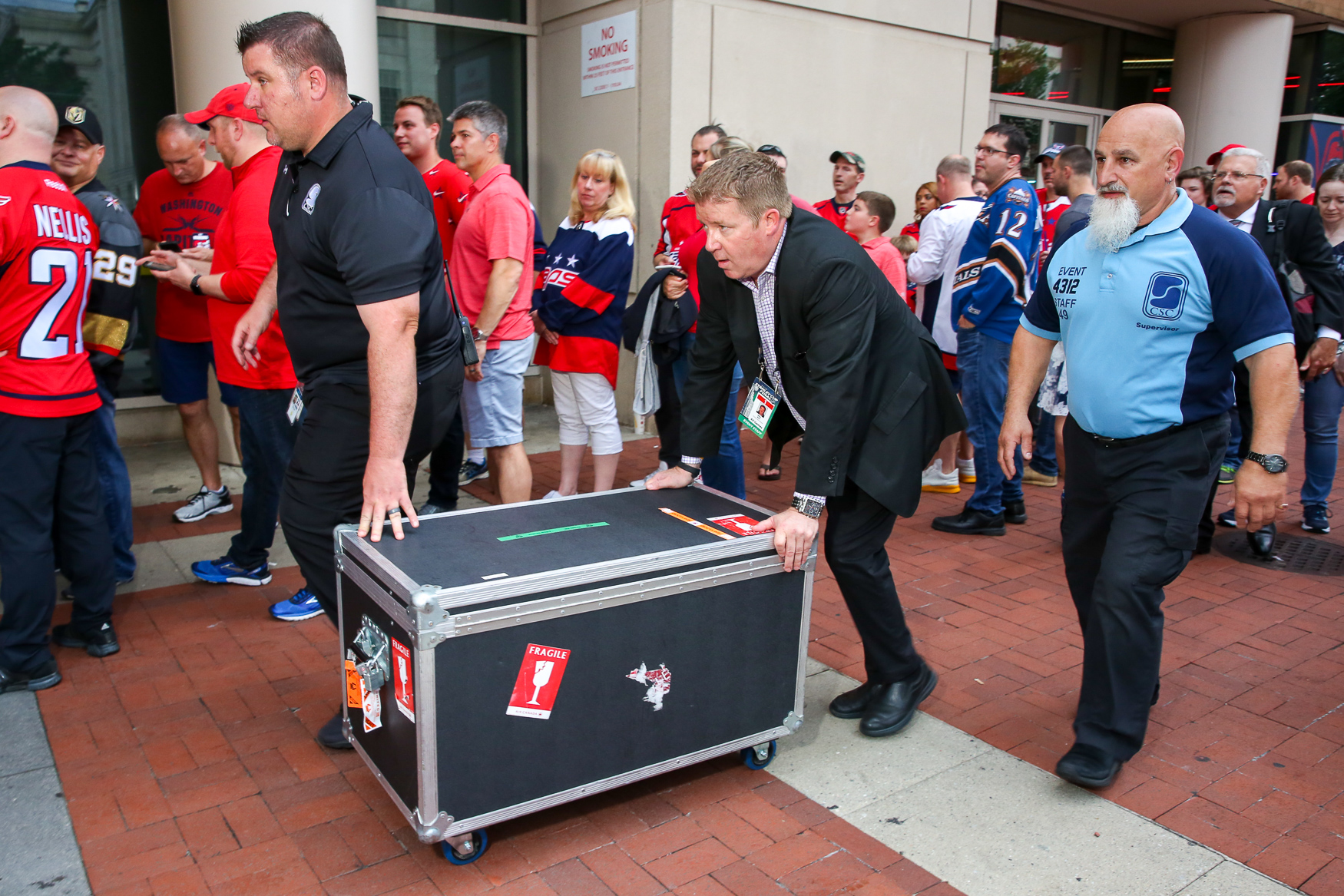 The Stanley Cup being taken into Capital One Arena. (Amanda Andrade-Rhoades/DC Refined)