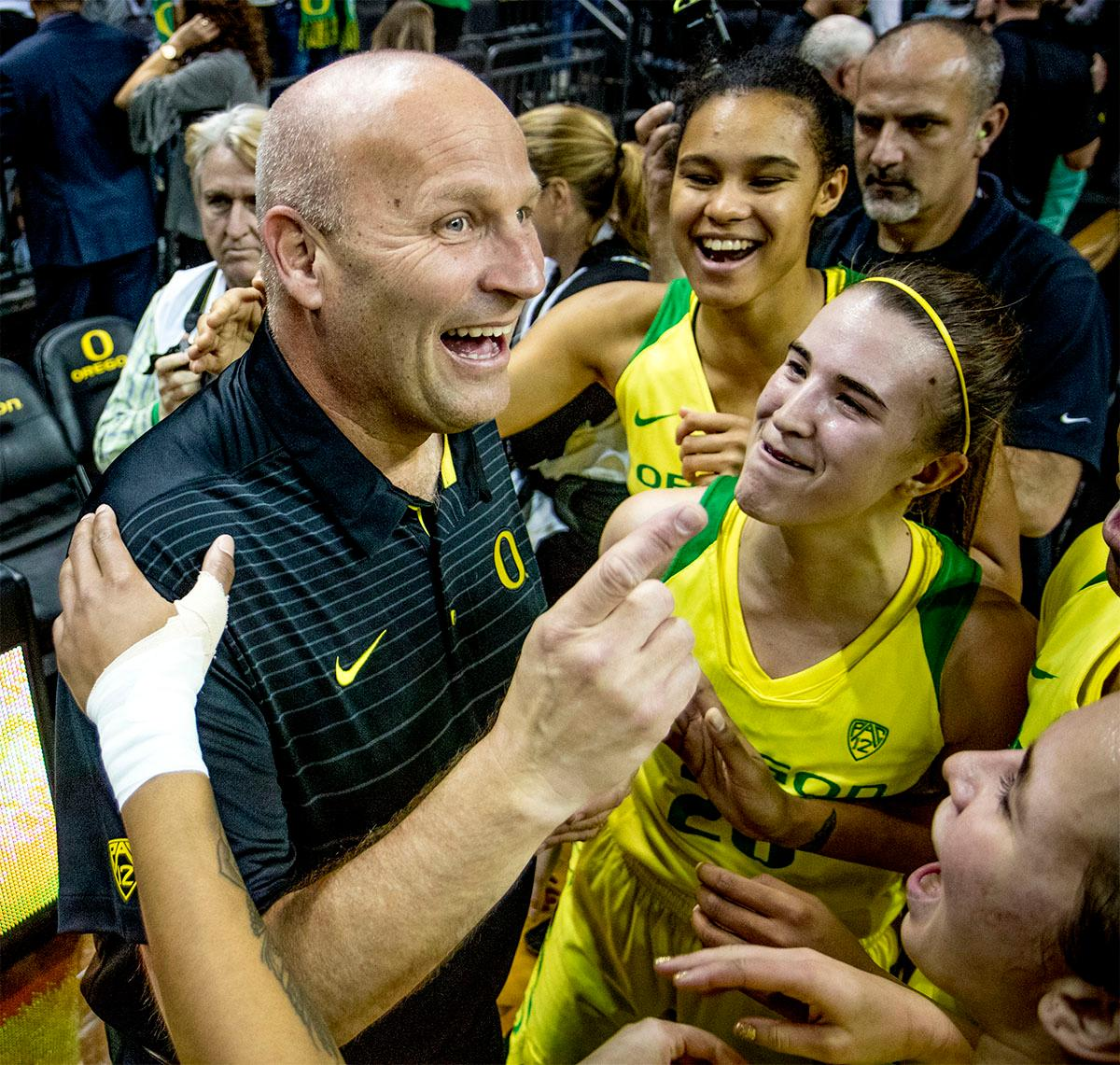 Ducks Head Coach Kelly Graves is congratulated on his 500th career win by his team. The Oregon Ducks defeated the Washington Huskies 94-83 on Sunday at Matthew Knight Arena. Sabrina Ionescu also set the new NCAA all time record of 8 triple doubles in just 48 games. The previous record was 7 triple doubles in 124 games, held by Susie McConnell at Penn State. The Ducks will next face off against USC on Friday January 5th in Los Angeles. Photo by Rhianna Gelhart, Oregon News Lab