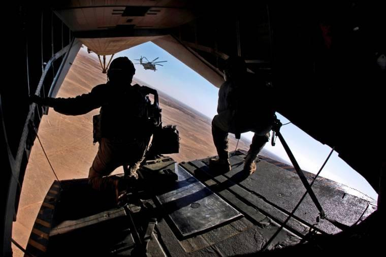U.S. Marine Corps Cpl. Matthew D. Blanchard provides aerial security from inside a CH-53E Super Stallion helicopter over Helmand province, AFG. Blanchard is assigned to Heavy Helicopter Sq. 462. The unit supported Marines during an interdiction operation.