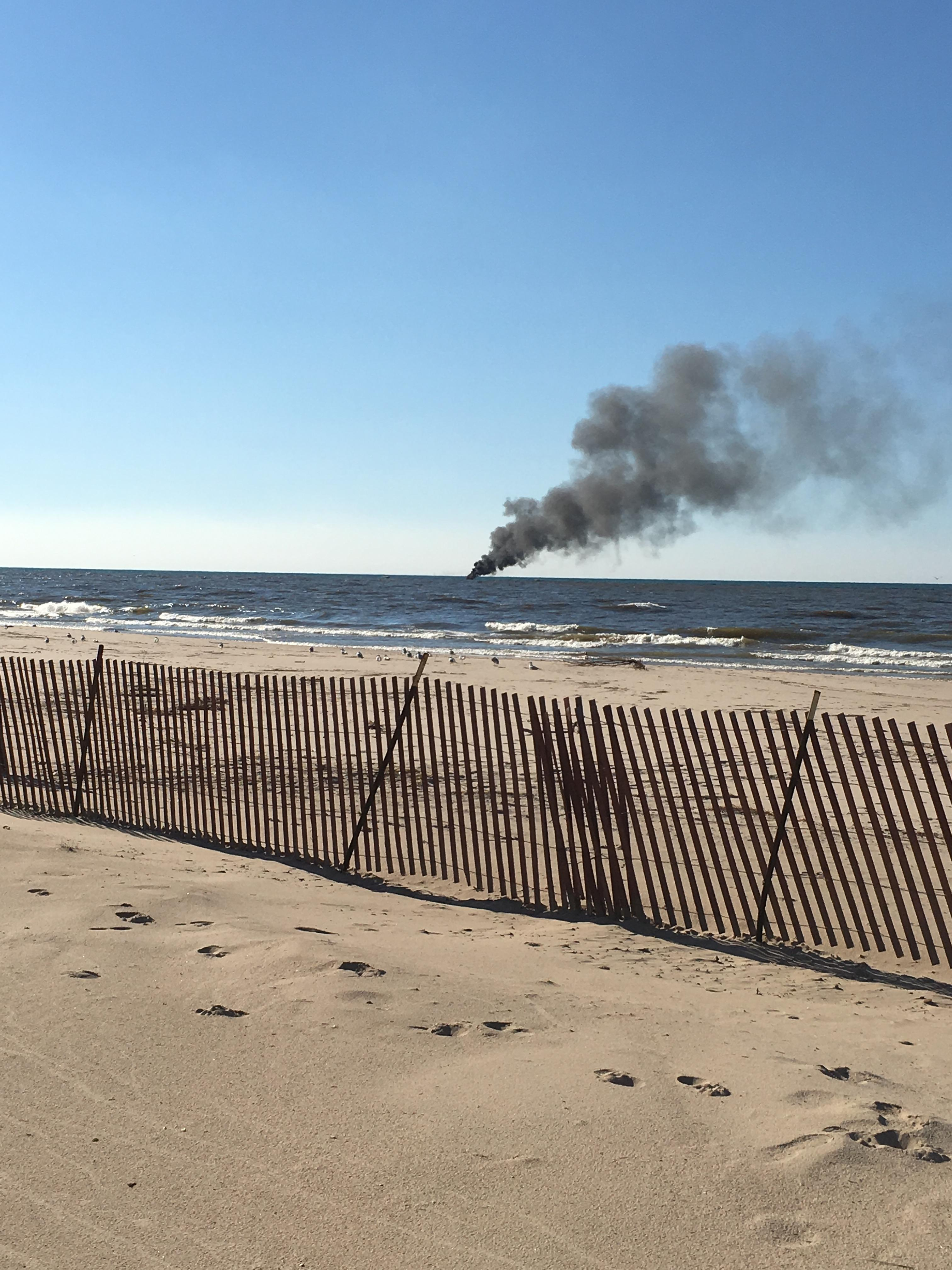 South Haven Area Emergency Services responded to a boat explosion and fire off the South Haven pier in Lake Michigan. (Courtesy of Trevor Clayton)